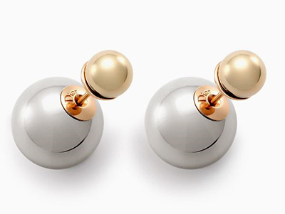 """""""Dior's tribal earrings feel as on point now as ever. These are an update on the original pearls and a dash more modern.""""   DIOR  Gold and Palladium finish earrings,  £310  www. Dior.com"""