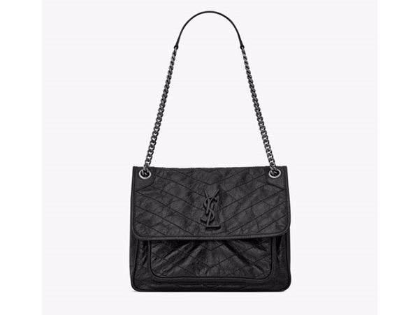 """""""You can't beat a Saint Laurent handbag. Anthony Vacarello has cleverly reinstated Yves' original logos, we love this heavy pewter chain too.""""   SAINT LAURENT by Anthony Vaccarello  Chain and leather bag  £1450  www. ysl.com"""