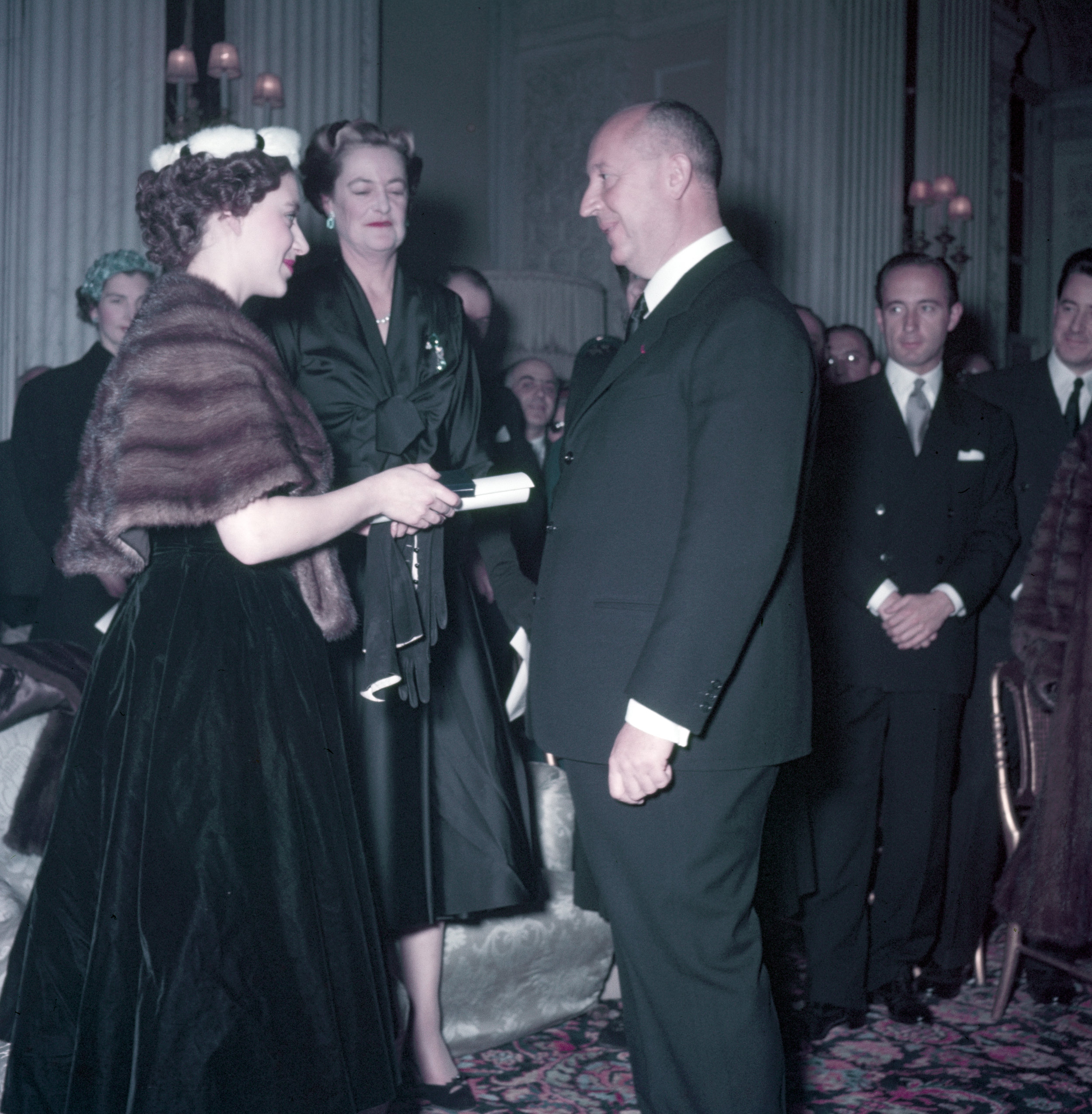 Princess Margaret presents Christian Dior with a scroll entitling him to Honorary Life Membership of the British Red Cross © Popperfoto, Getty Images.jpg