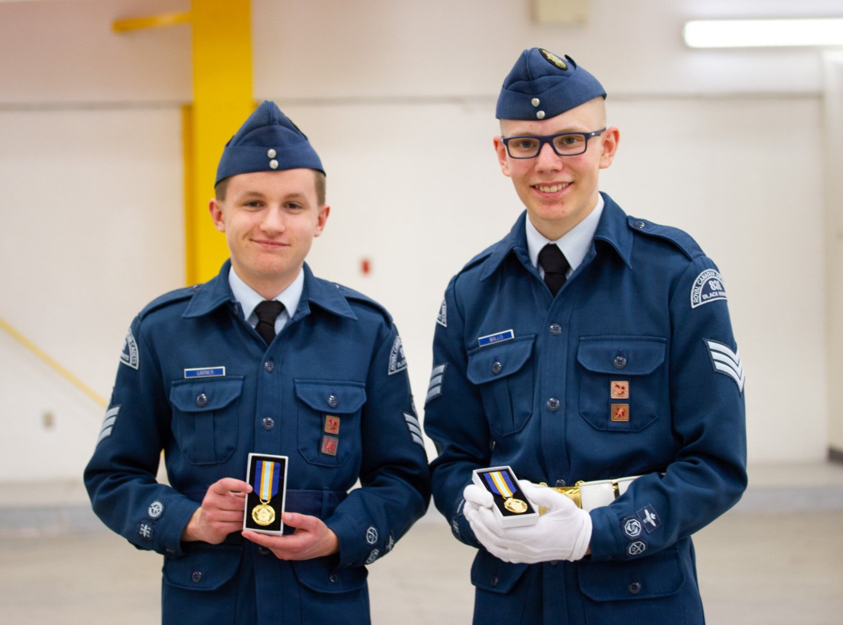 FSgt Garner (L) and Sgt Wallis (R) proudly displaying their long service medals at the 2019 Annual Ceremonial Review.