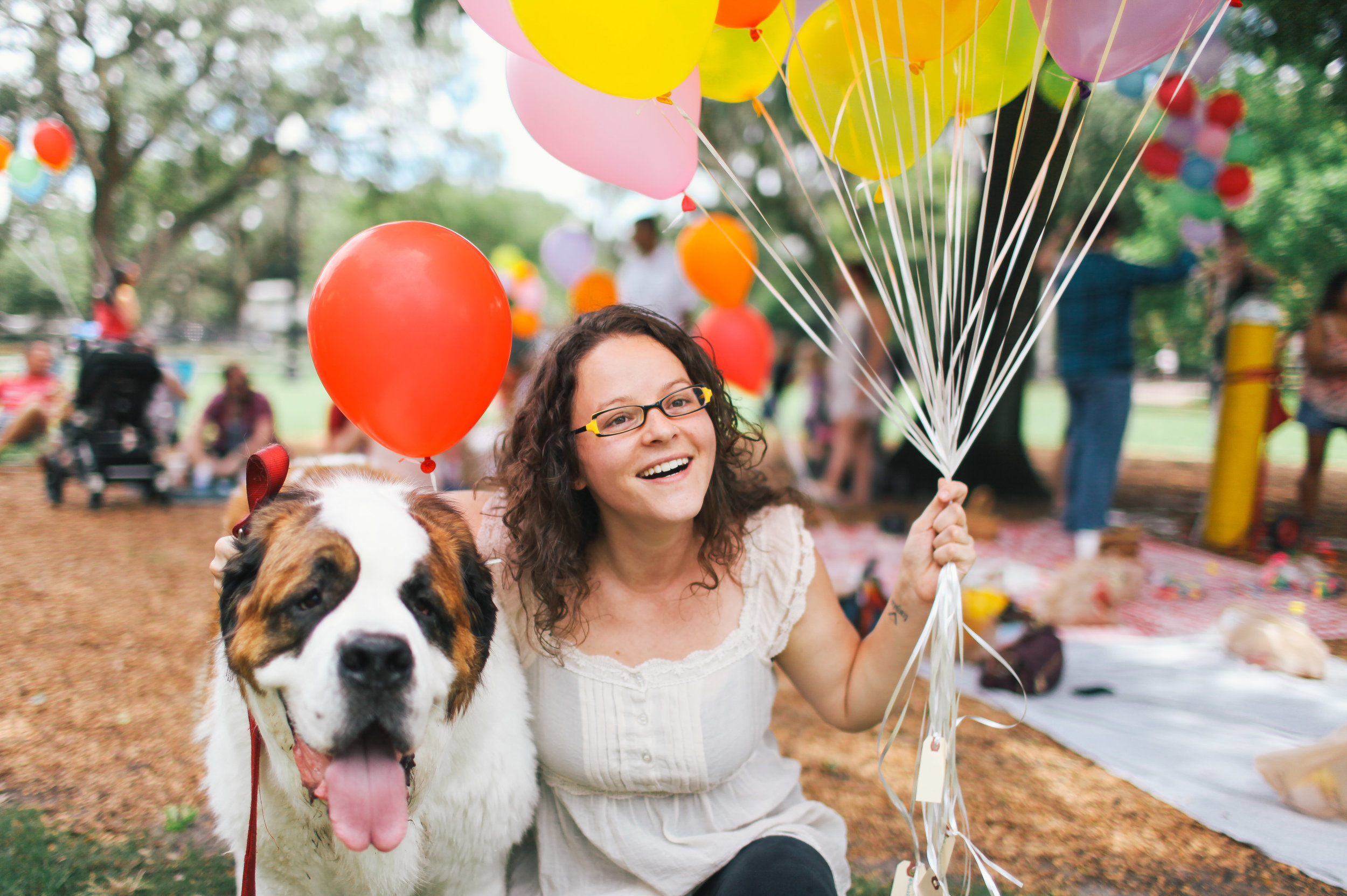 happy woman with a dog and ballons
