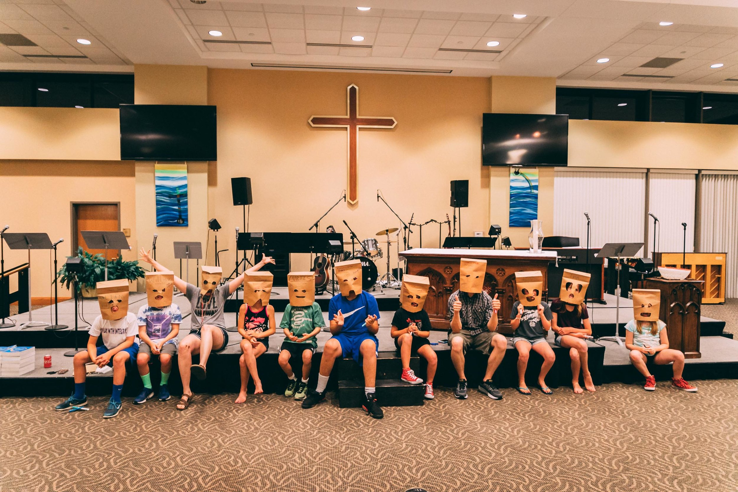 Preteens have fun in a team building exercise at an all-night lock-in last summer.