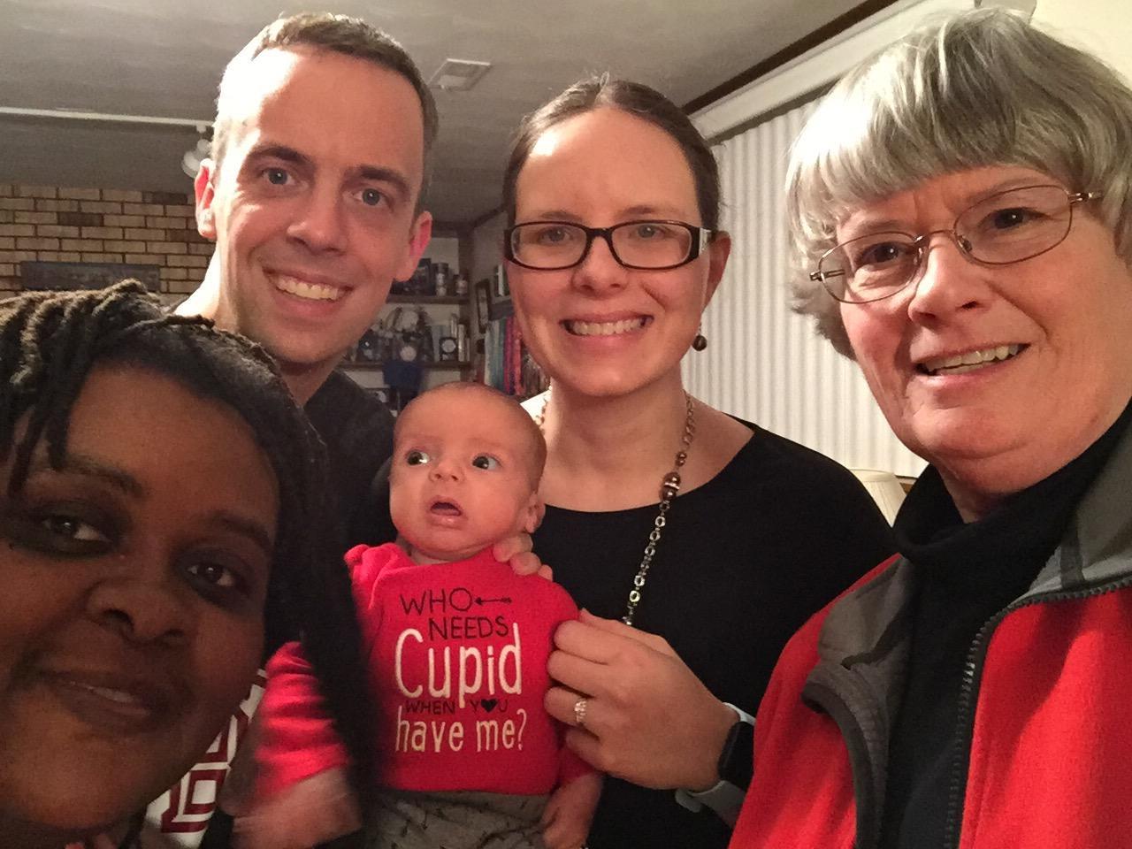 Wes, Amanda and Elijah Johnson, Sundae Johnson, and Pastor Pam after Elijah's crib blessing