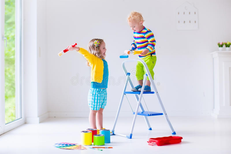 children-painting-walls-home-family-remodeling-house-remodel-renovation-kids-colorful-brush-roller-paint-wall-56408102.jpg