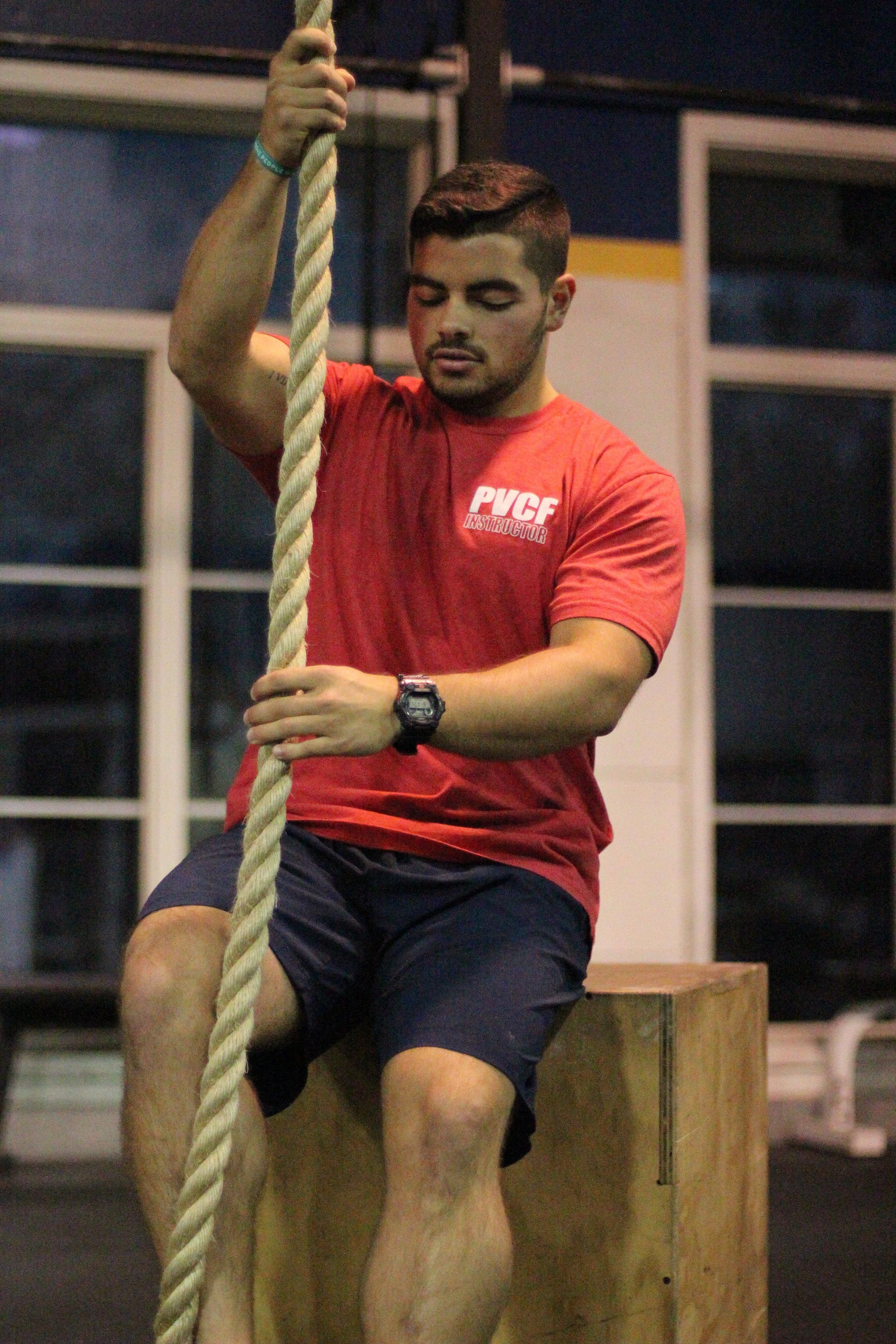 Coach Will prepares to teach the rope climb!
