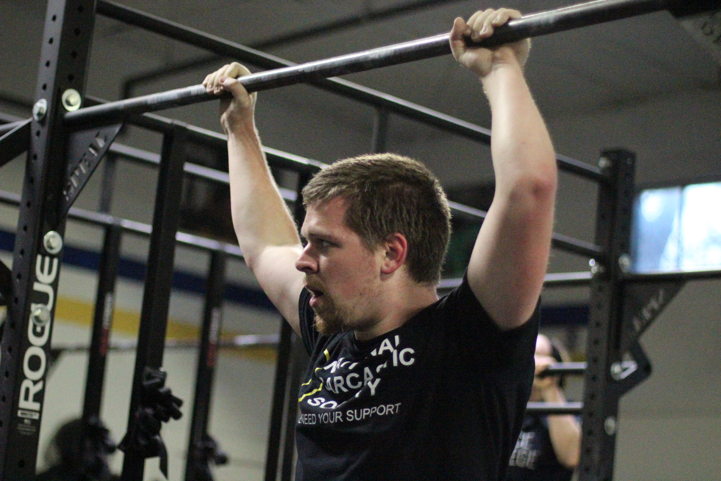PVCF athlete,Nicholas Whitman checks out the clock during a set of pull ups.