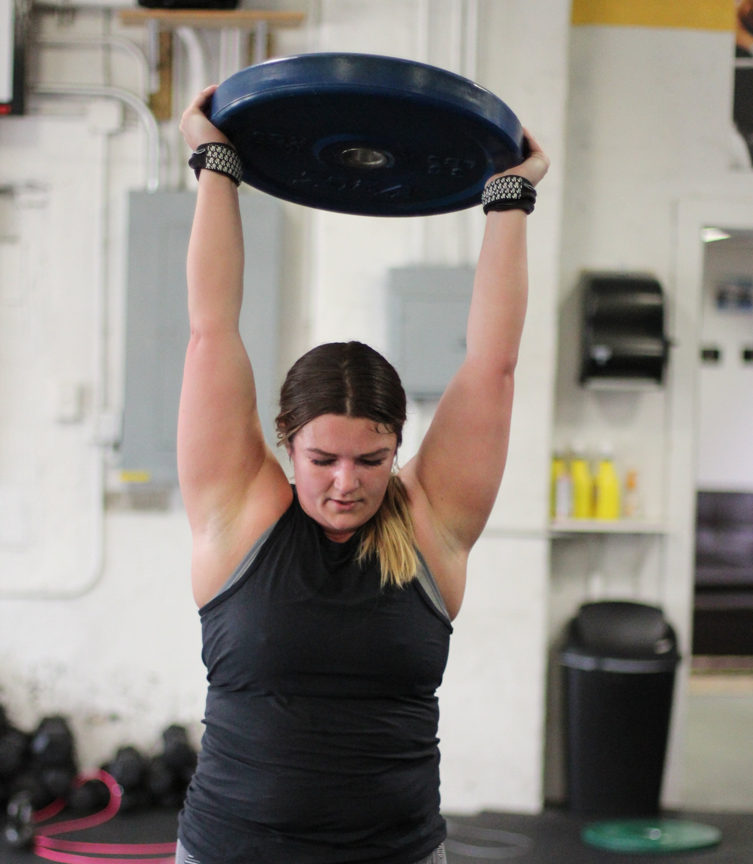 PVCF Hiit Coach Jessica Morse gets after the Overhead Walking Lunges!