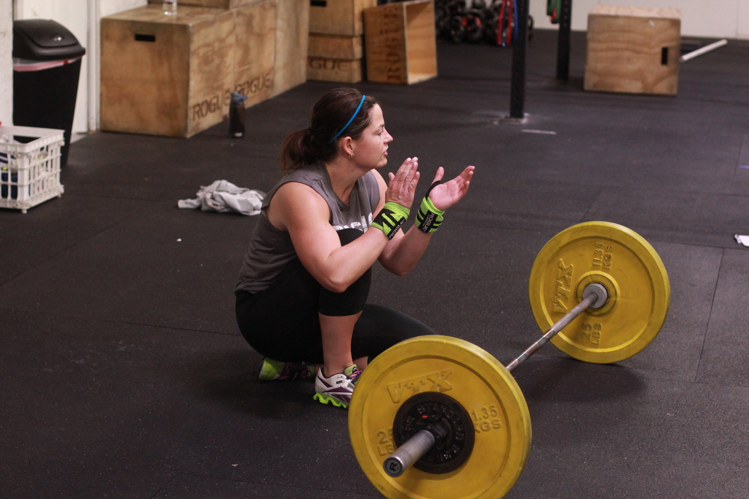 PVCF athlete, Loren Davine cheers after finishing the workout. In CrossFit, we support every single person rather than the individual - that's extraordinary!