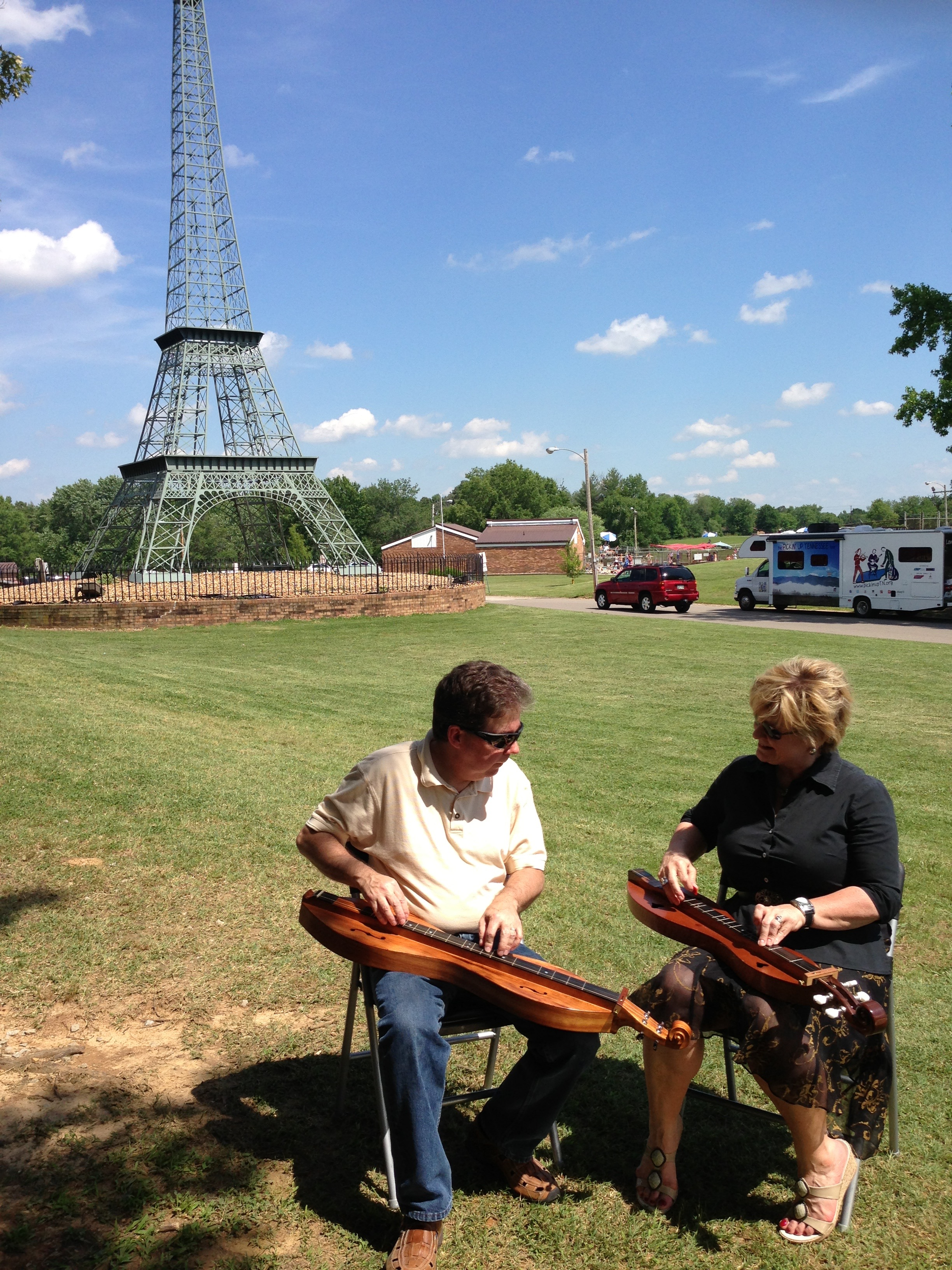 "Larry and Elaine Conger perform Larry's dulcimer melody ""September on the Mississippi"" at Eiffel Tower Park in Paris on Day 9 of the tour."