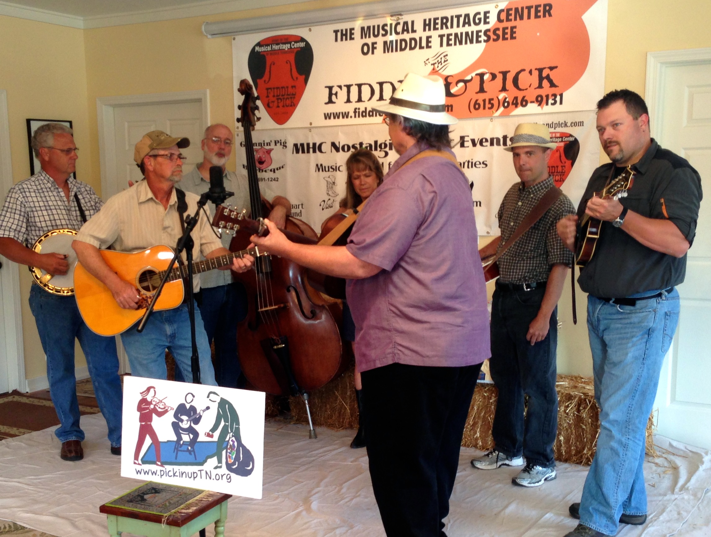 "Pickin' Up Tennessee's music didn't get any better than this: (L to R): Wade Dawson, David Spicer, Bill Baldock, Gretchen Priest-May, Tom ""Tree"" Reynolds, Tim May and David Martin performed Stephen Foster's 19th century ballad ""Angelina Baker"" at Fiddle & Pick in Pegram."