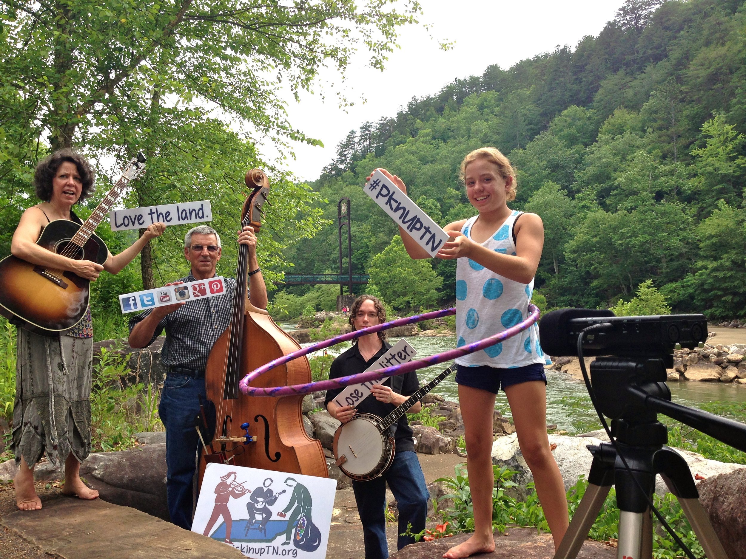 The next-to-last performance of the Pickin' Up Tennessee Tour: Playing on the Planet (Lisa Jacobi , Dennis Mixon, Jarrod Payne and Seu Jacobi on hoops) plays on the Ocoee River.