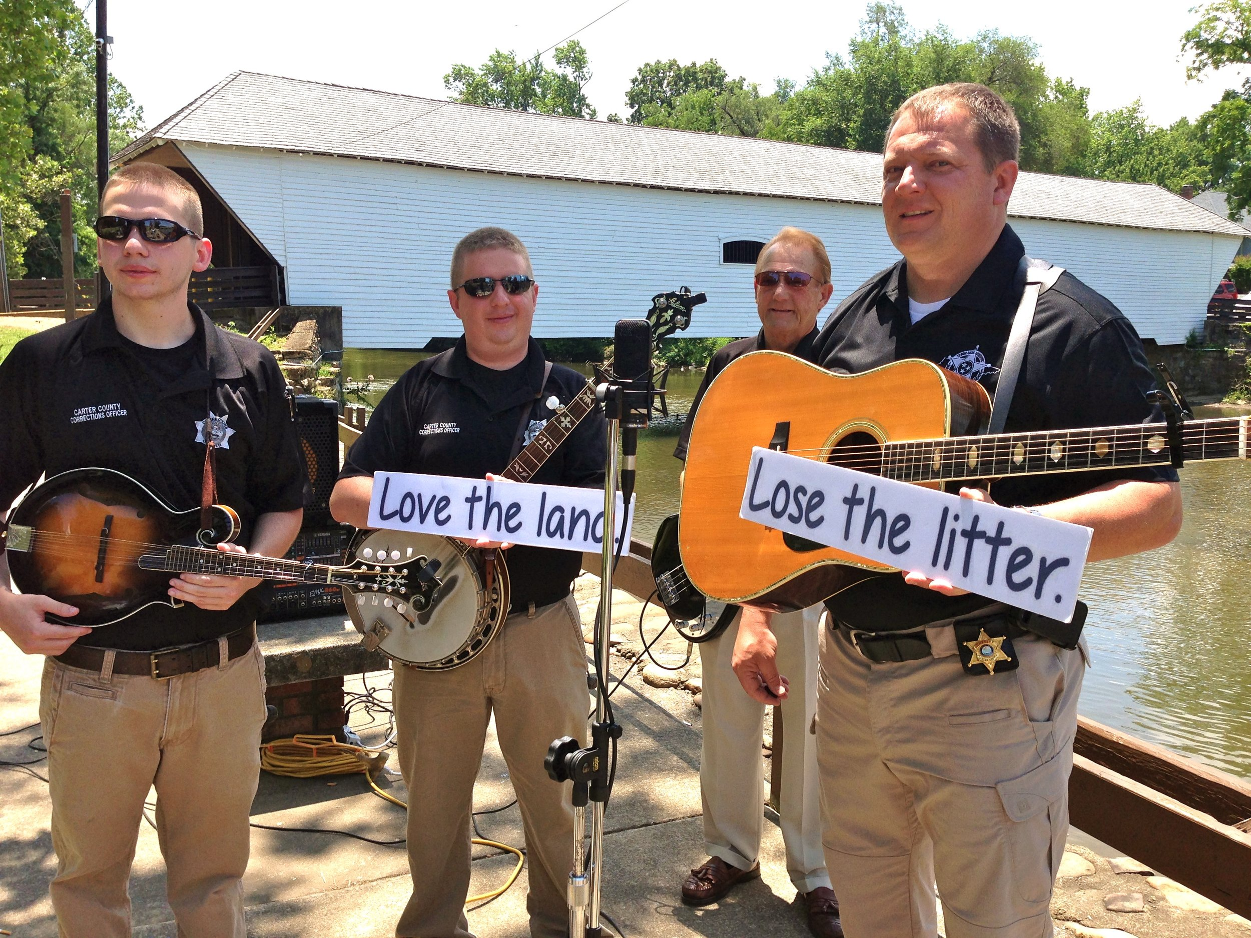Sheriff Chris Mathes and the All-Star Jailbird Band at Elizabethton's Covered Bridge on Doe Creek. R to L: Justin Hamm (mandolin), Jackie Mathes (bass guitar), John Hamm (banjo), Chris Mathes (guitar)