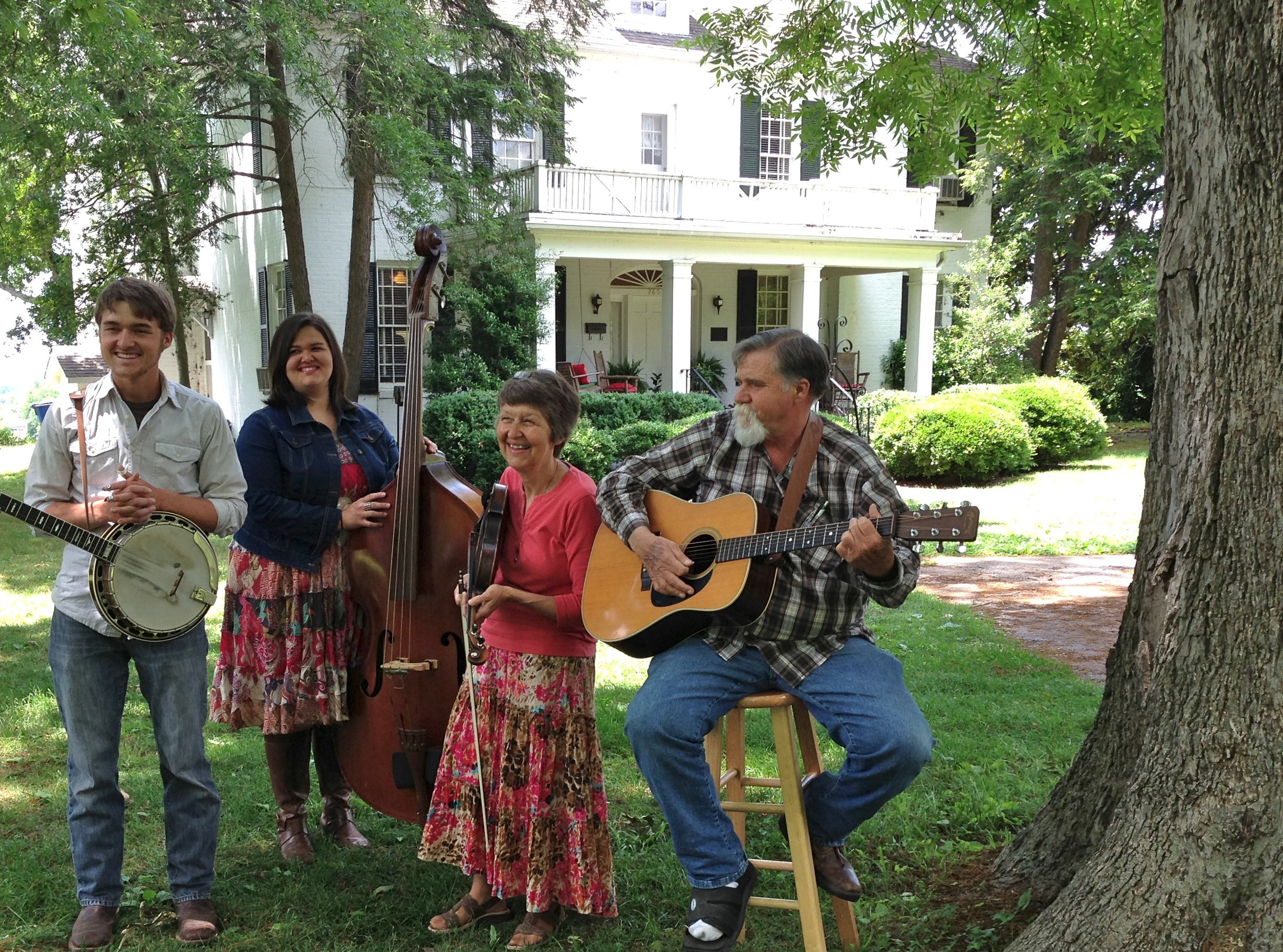 The Holt Family—Daniel Ray, sister Melody, and parents Martha Lynn and Danny Ray Holt, performed on the broad, shady lawn of Savannah's antebellum Cherry Mansion overlooking the Tennessee River.