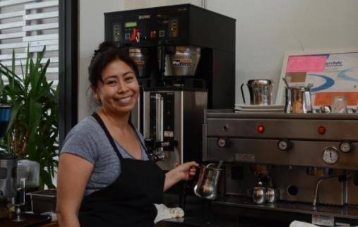 Alejandra, owner and operator of Un Cafecito 335 Jones Street