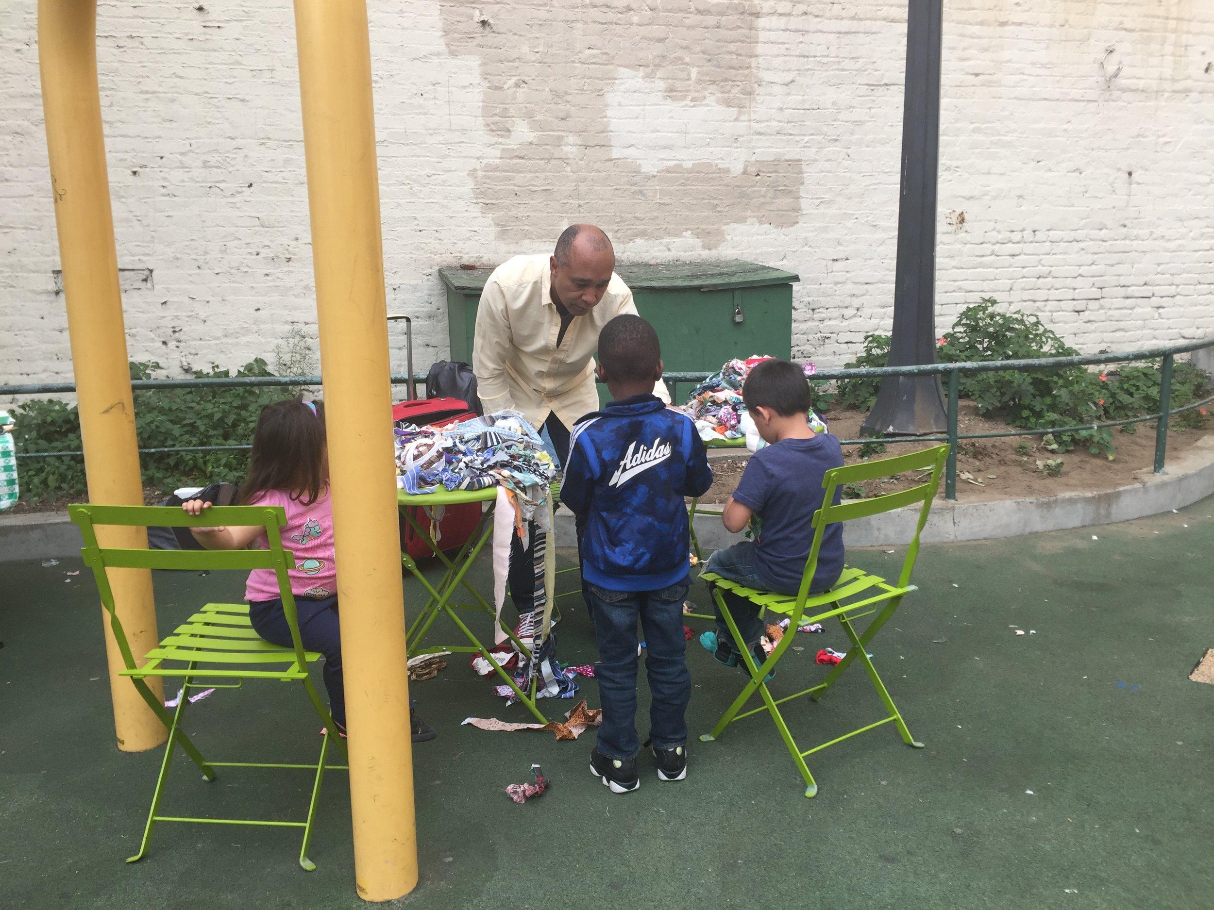 Ramekon O'Arwistersdemonstrates weaving techniques for Tenderloin youth during a recent Crochet Jam at Turk Hyde Mini Park.