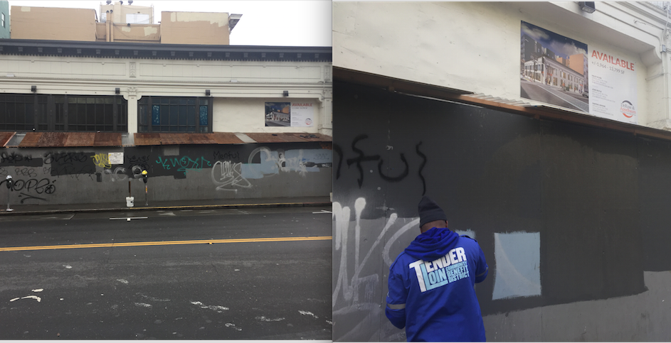 In this photo, TLCBD removes graffiti from a construction barricade.