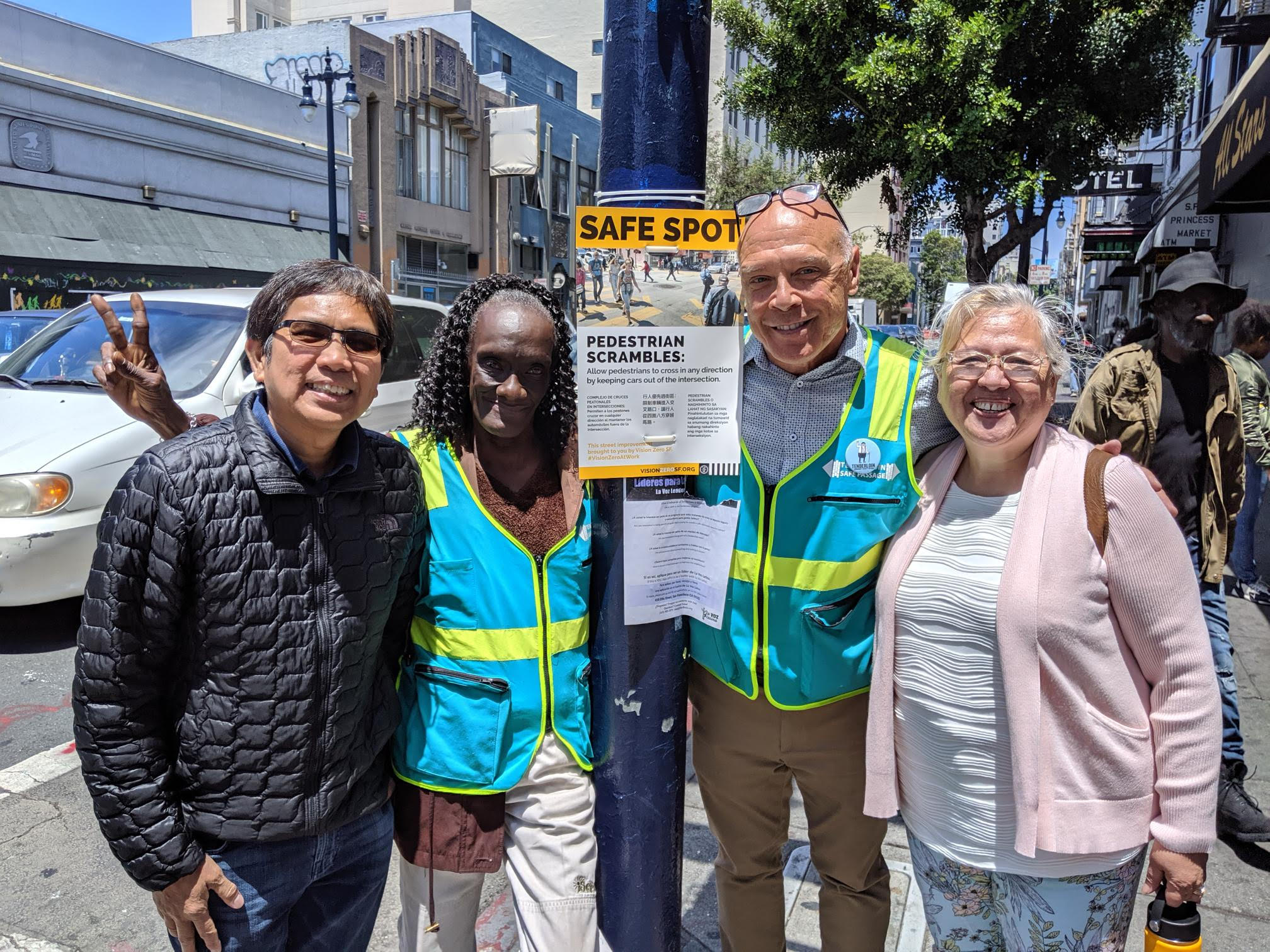 Signage placement & community outreach surrounding the pedestrian scramble with TLCBD Safe Passsage, TNDC, and SFMTA