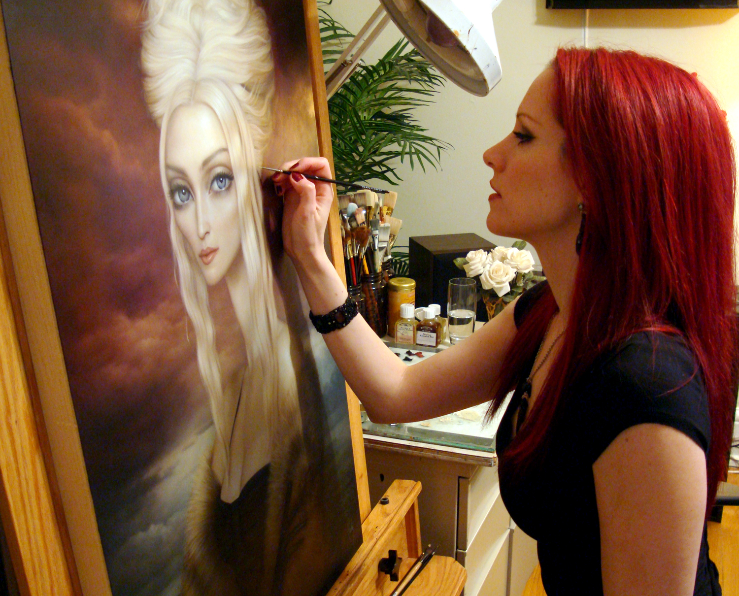 """Lori Earley at her easel in 2009 painting her comissioned piece titled, """"Portrait of Ms. Ciccone"""" Oil on board ©Lori Earley."""
