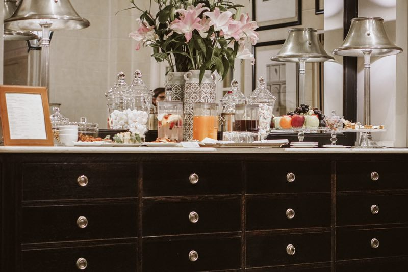 The beautiful sideboard is laid with jars of sweets, fresh fruits, home -made cakes , hot and cold drinks to which guests can help themselves.