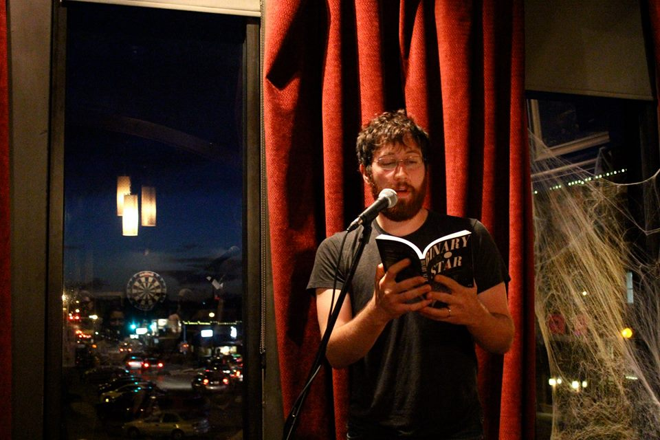 Colin at a reading in Denton c. 2014   photo by courtney marie