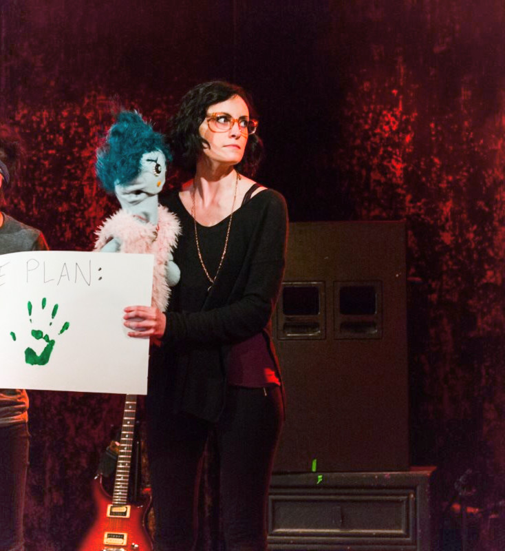 Liz King  {she/her/hers}  experimental theater, performance art, satirical articles, sketch comedy, crafting   With all the time saved not learning basic computer skills, Liz focuses her adult life on comedy writing and performance art. Other interests include puppetry, rummaging through old photos in antique stores, and aimless walking.