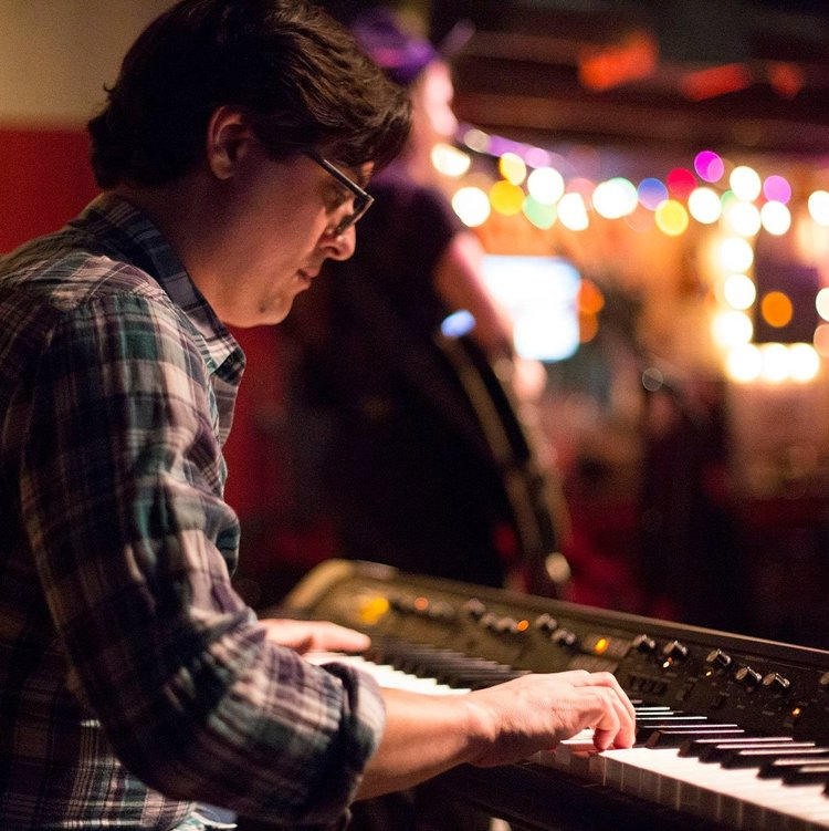 Jacob Greenan  {he/him}  music, producer   Jacob Greenan is a multi-instrumental musician and studio & production assistant at Shiny Sound Recording Studio. Jacob has been known to play everything from piano to an upright bass over the years across the great state of Texas in such projects as The Hazardous Dukes, Forever & Everest, and Here In Arms.   Instagram