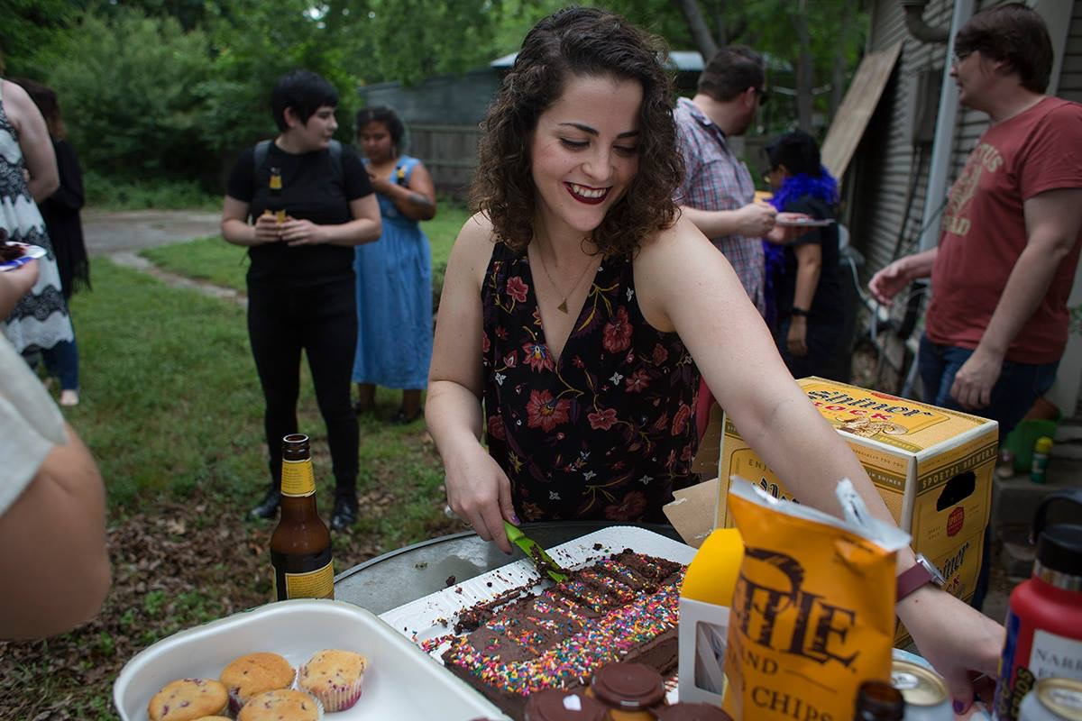 Caitlin Childs  {she/her}  butter   A lover of learning, Caitlin has attended culinary school, an ice cream class in Pennsylvania, and courses in everything from cheese-making to chocolate-baking. Her culinary expertise has found her in many a kitchen, as short order egg cook, a fine dining chef, kitchen manager, and even running a baked goods shop at the Denton Community Market. Born and raised in Denton, Caitlin is a longtime travel and food fanatic and spends most of her time browsing cheap flights and day dreaming of devouring pastries in Europe.   Instagram
