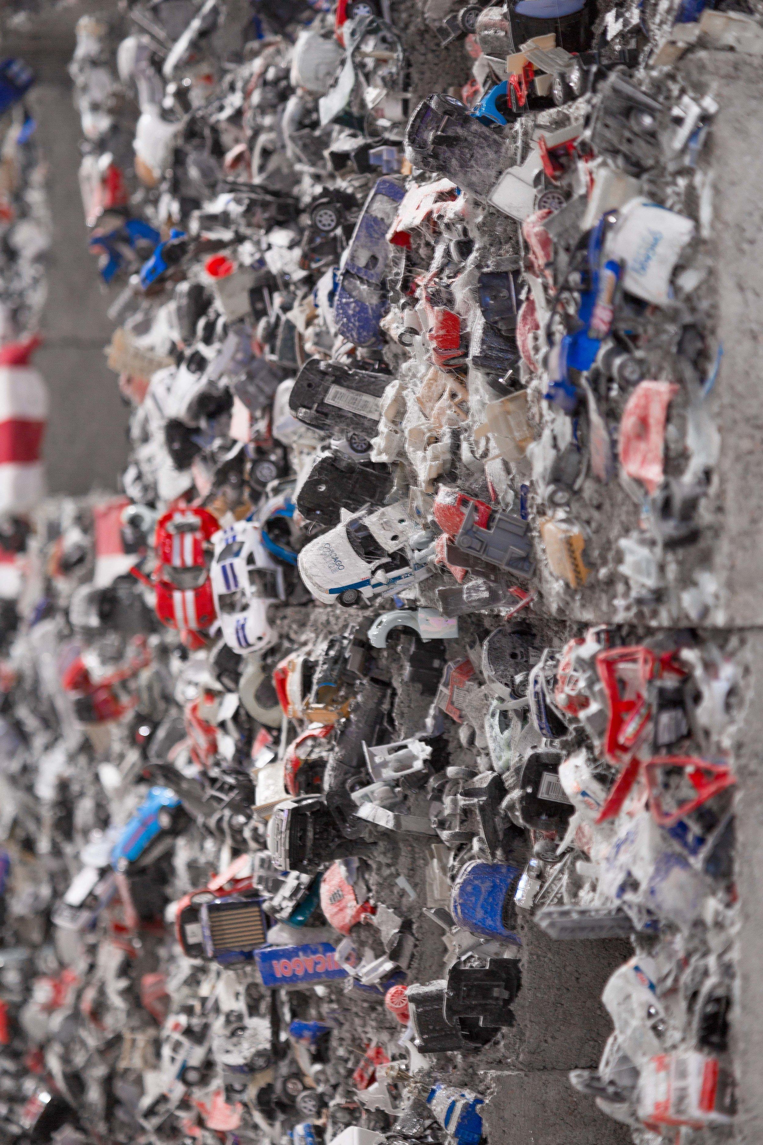 Detroit, 2019  concrete, toy cars, fans, U.S. flags (detail view)