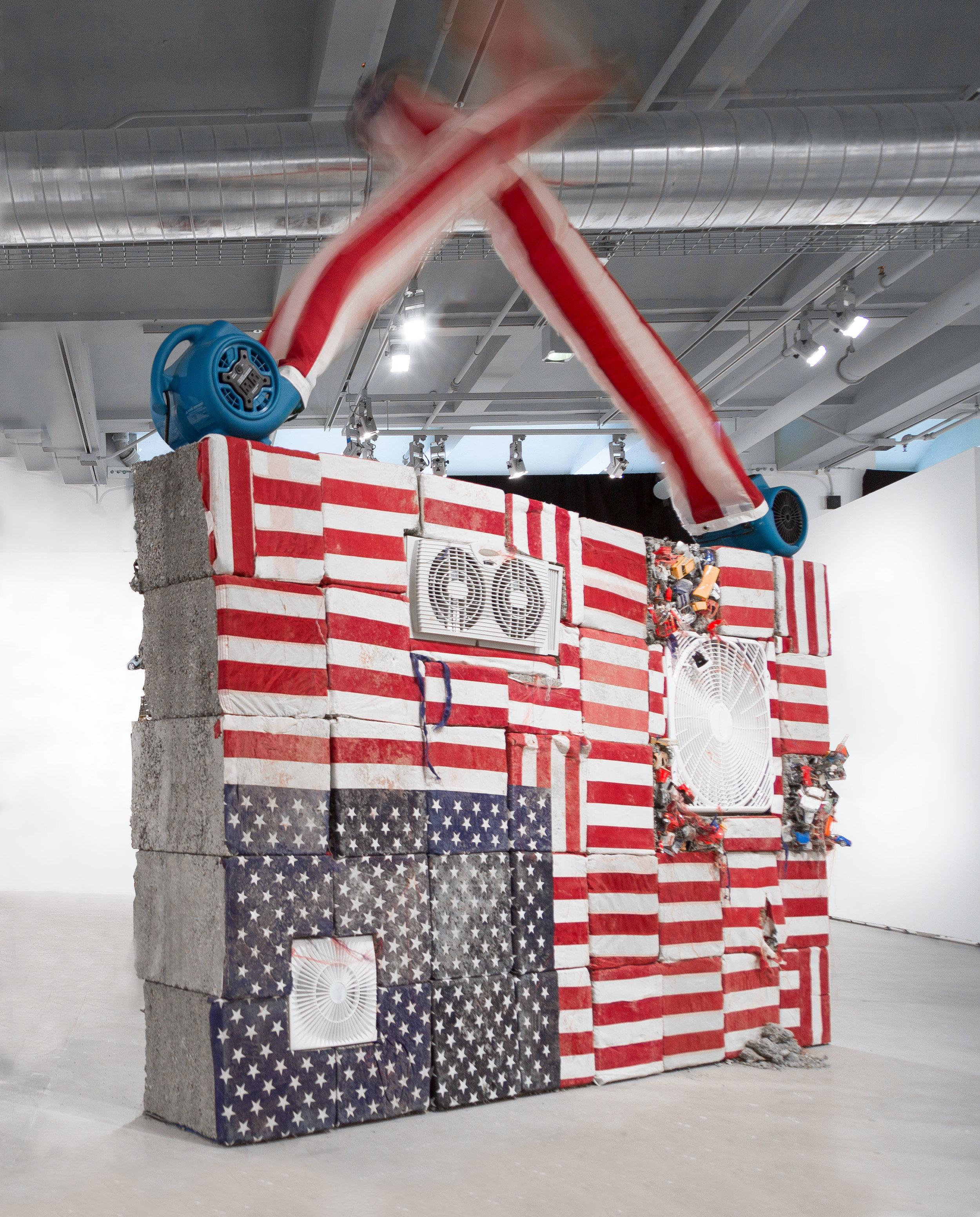 Detroit, 2019  concrete, toy cars, fans, U.S. flags (front view)