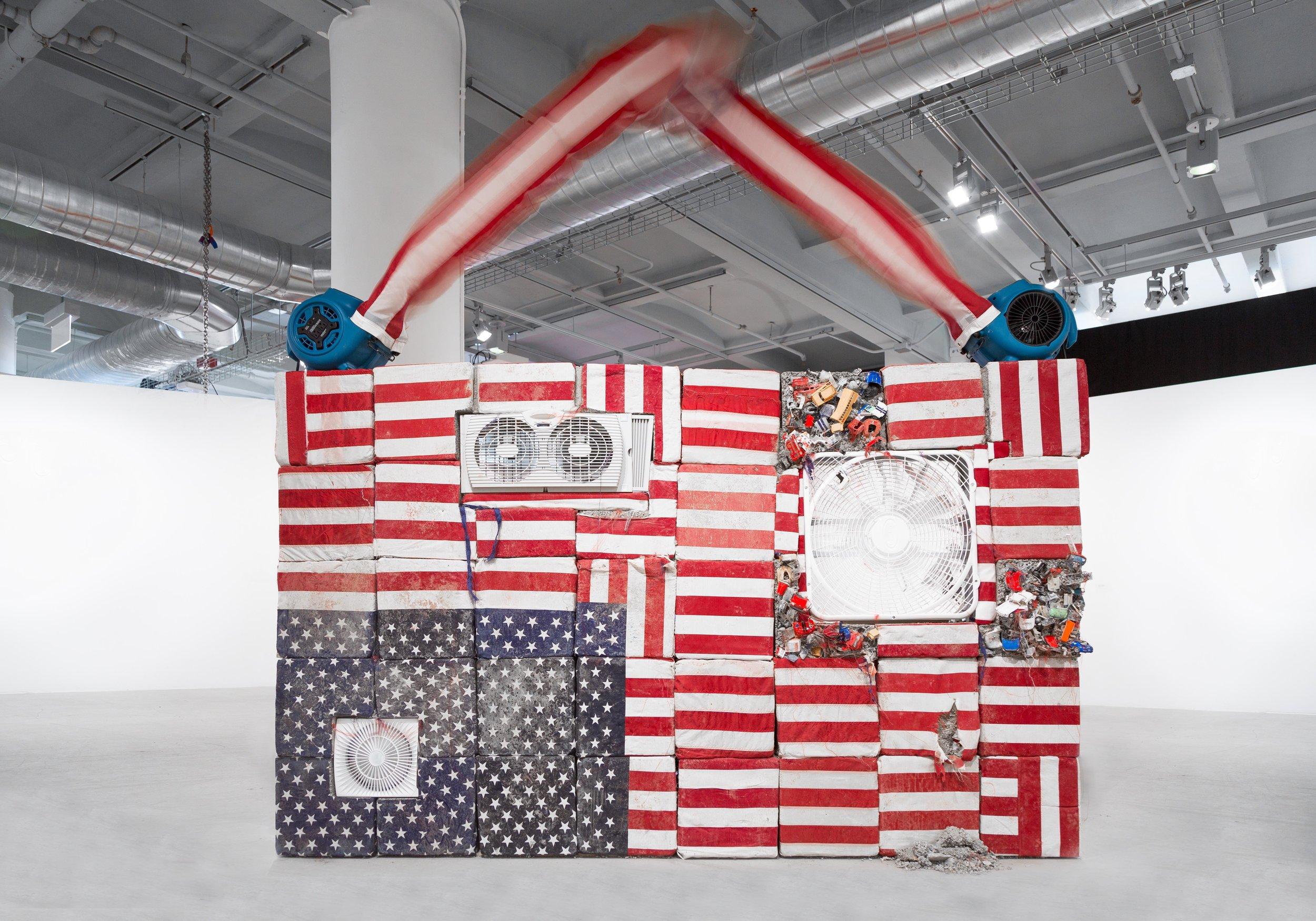 Detroit, 2019  concrete, toy cars, fans, U.S. flags