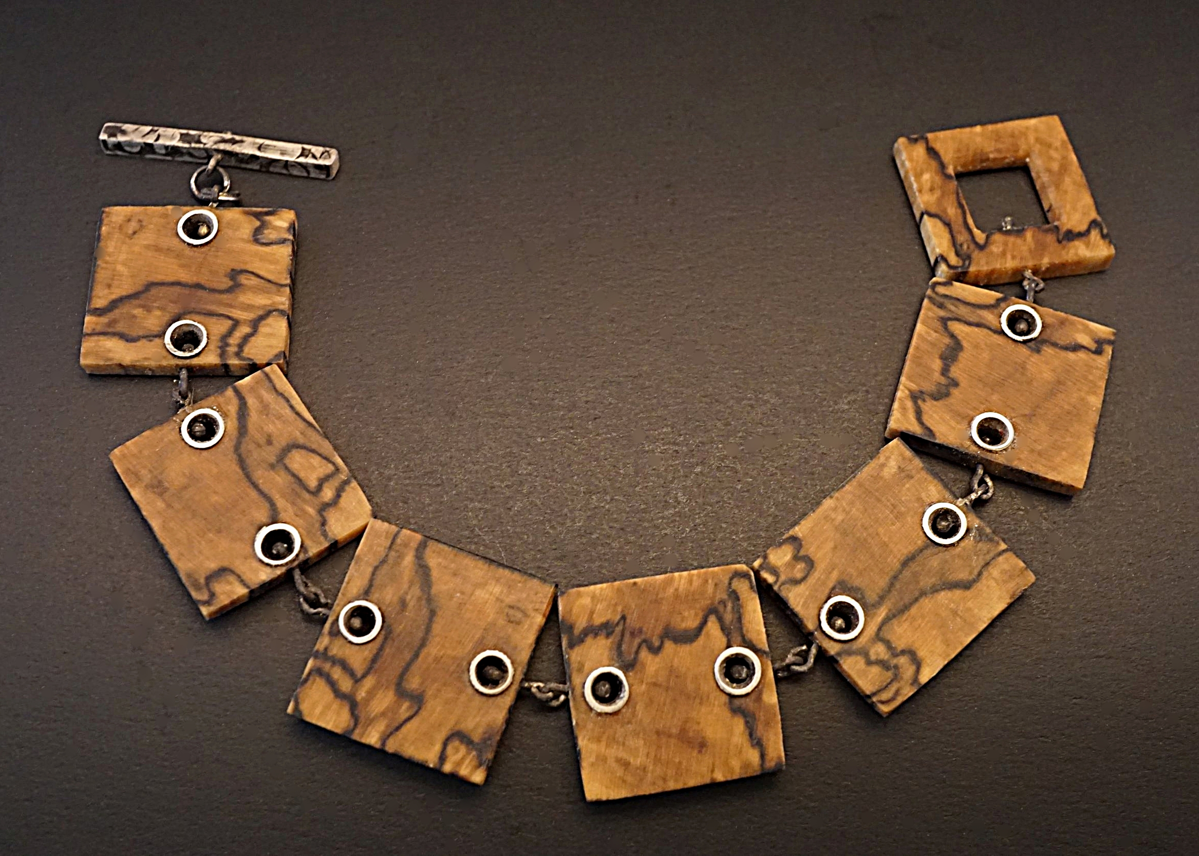 Hand carved spalted hackberry wood links with sterling silver rivets, links, and toggle