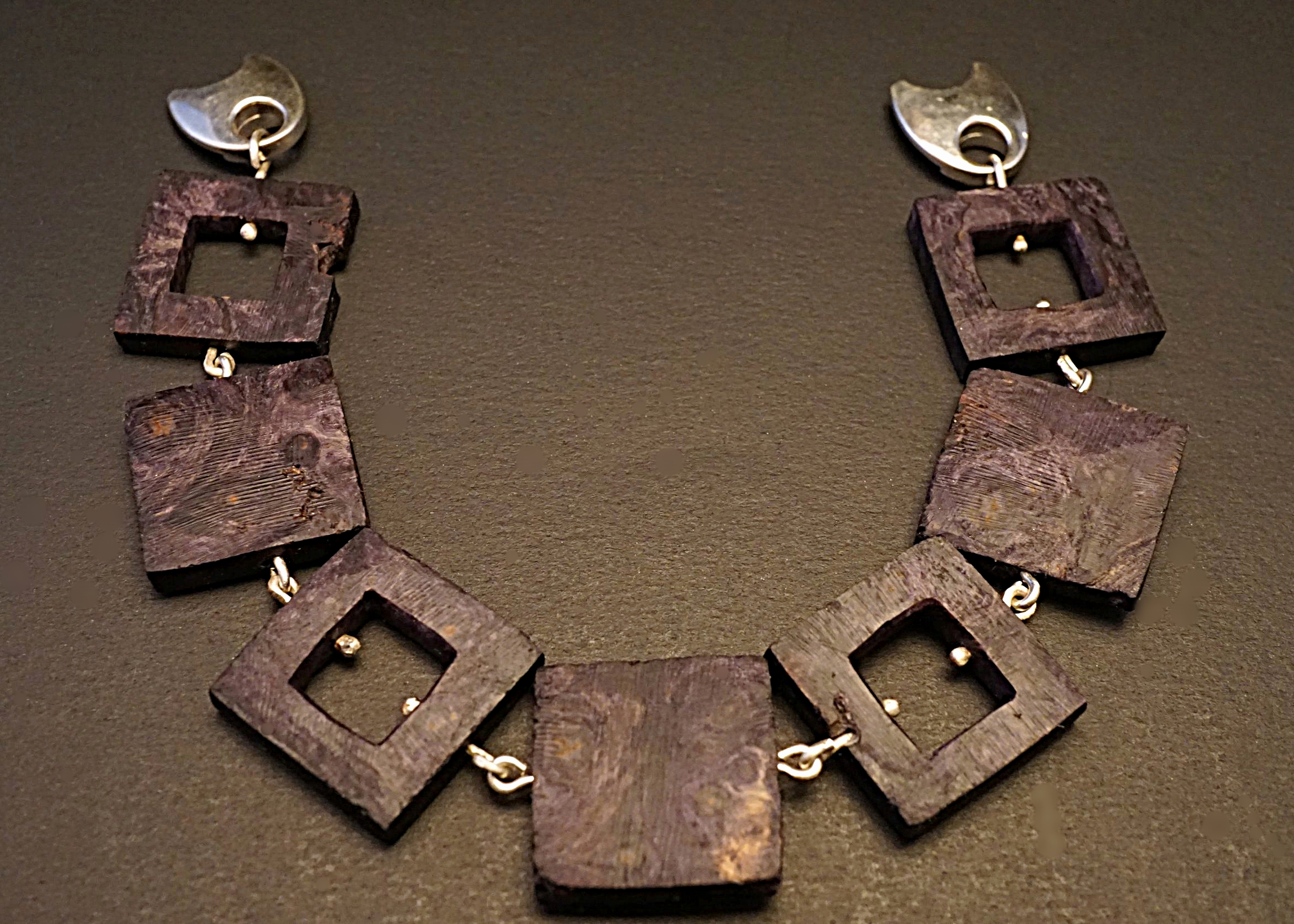 Hand carved buckeye burl links with sterling silver connectors and sterling silver magnetic clasp