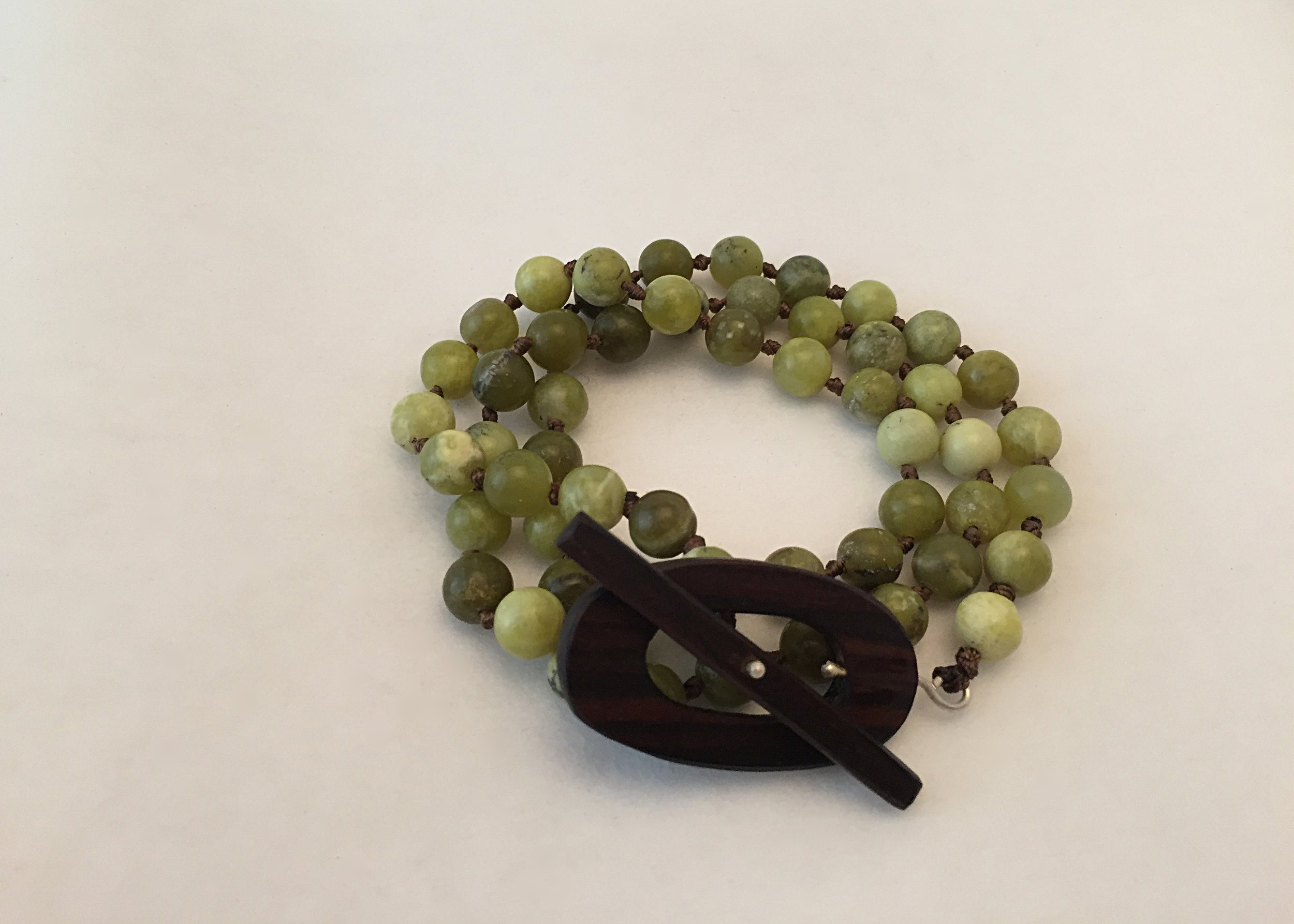 This moss jade can either be wrapped as a bracelet or worn as a necklace.