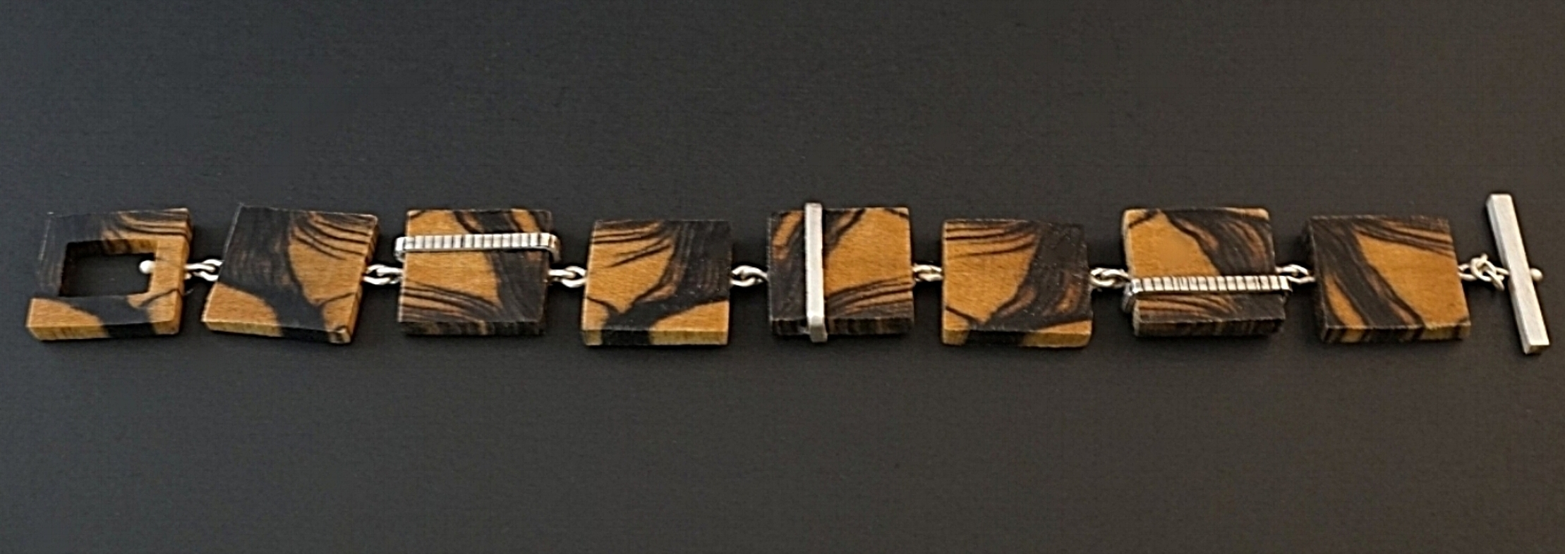 Black and white ebony hand carved bracelet with sterling silver