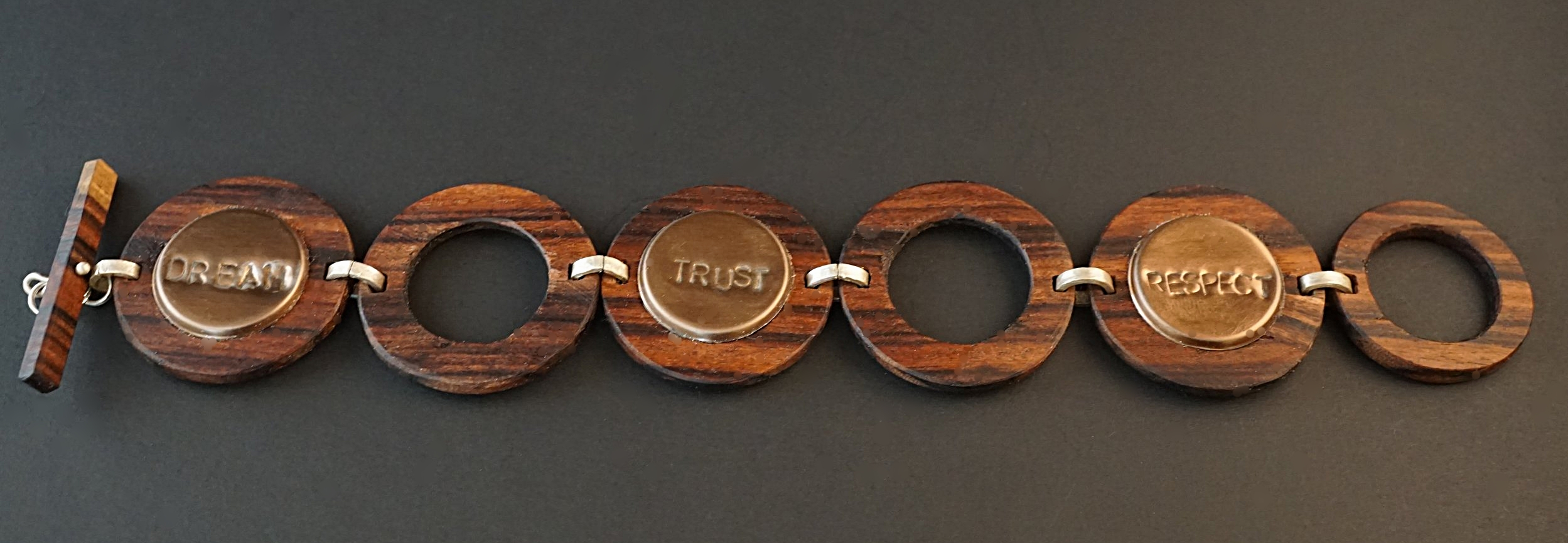 Bolivian Rosewood with hand stamped copper color tiles. Hand stamped with dream, trust, respect, family, faith, create