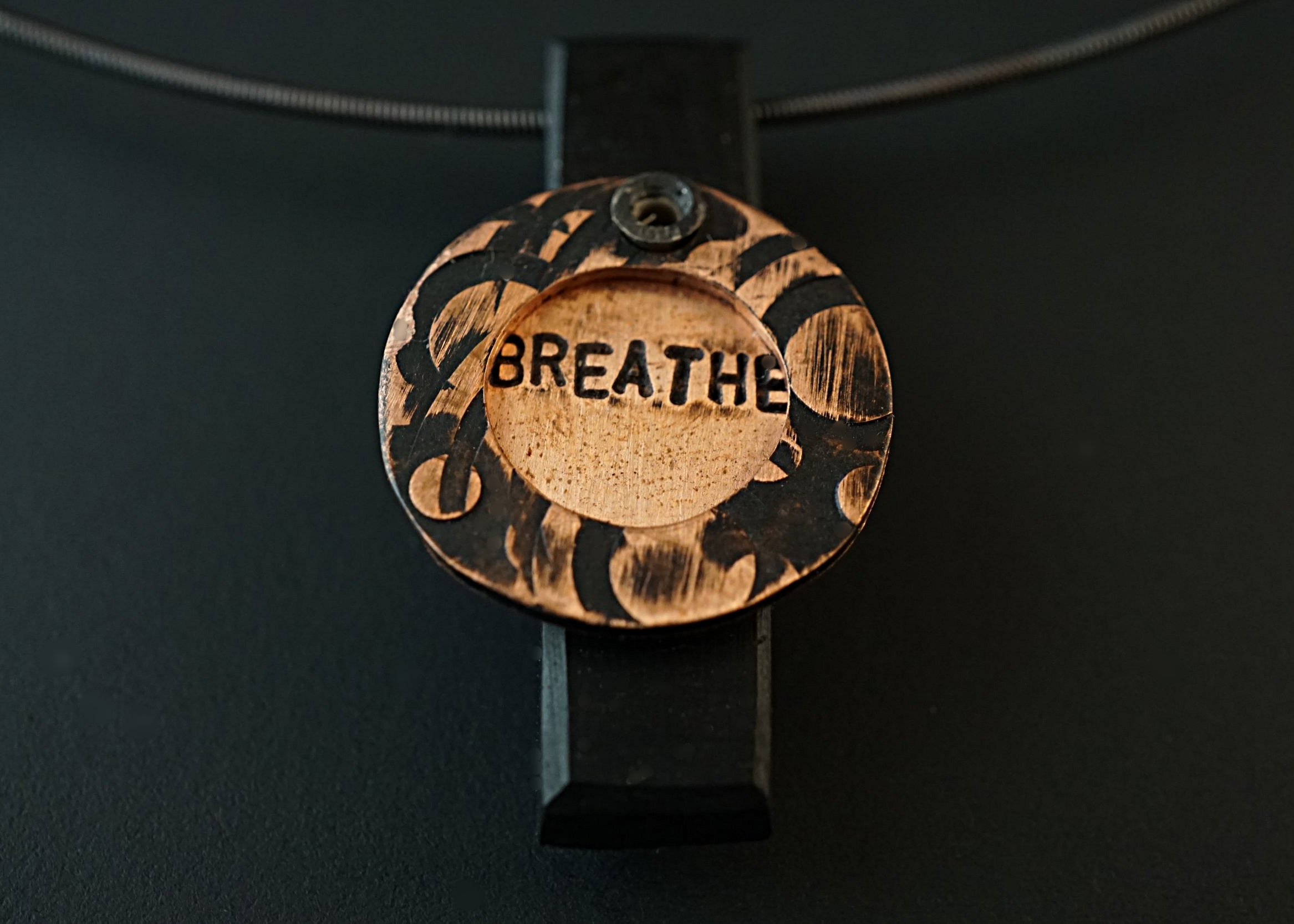 Breathe pendant with copper stampings and ebony