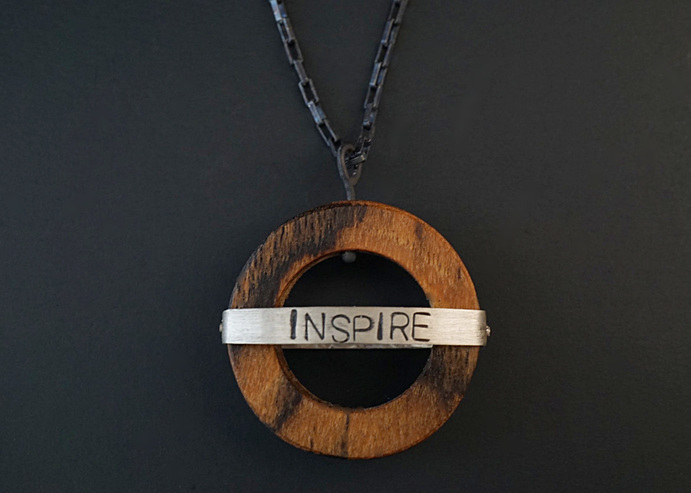 Bocote circular pendant with hand stamped sterling silver inspire