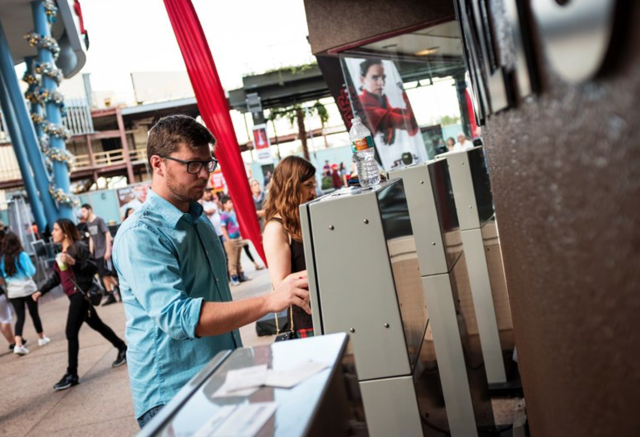 Dan Steven using his MoviePass to buy a ticket this week at the AMC Disney Springs 24 theater in Lake Buena Vista, Fla.  Credit: Jacob Langston for The New York Times