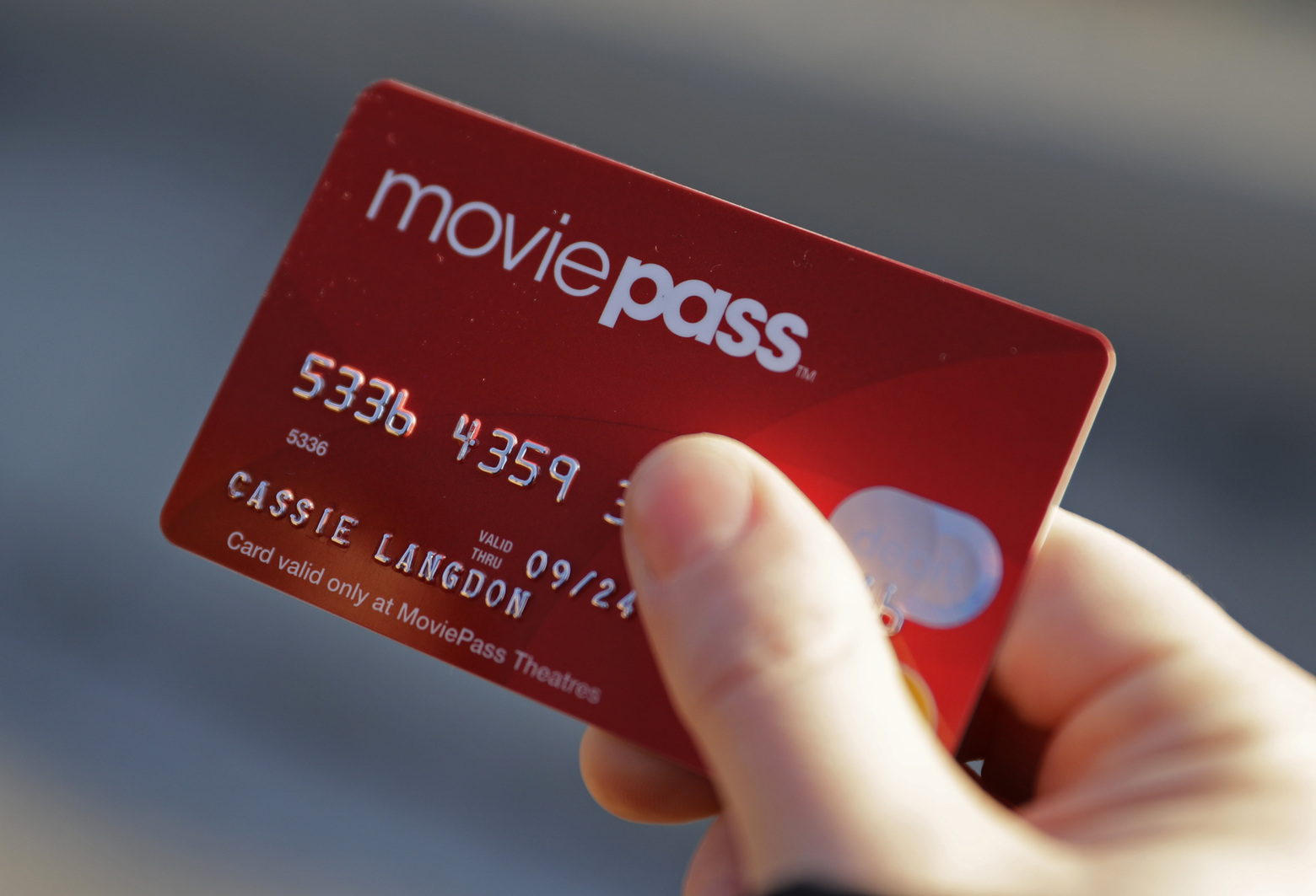 With her MoviePass card, Cassie Langdon says she's seeing more smaller releases in addition to blockbusters and sequels. (Darron Cummings/AP)