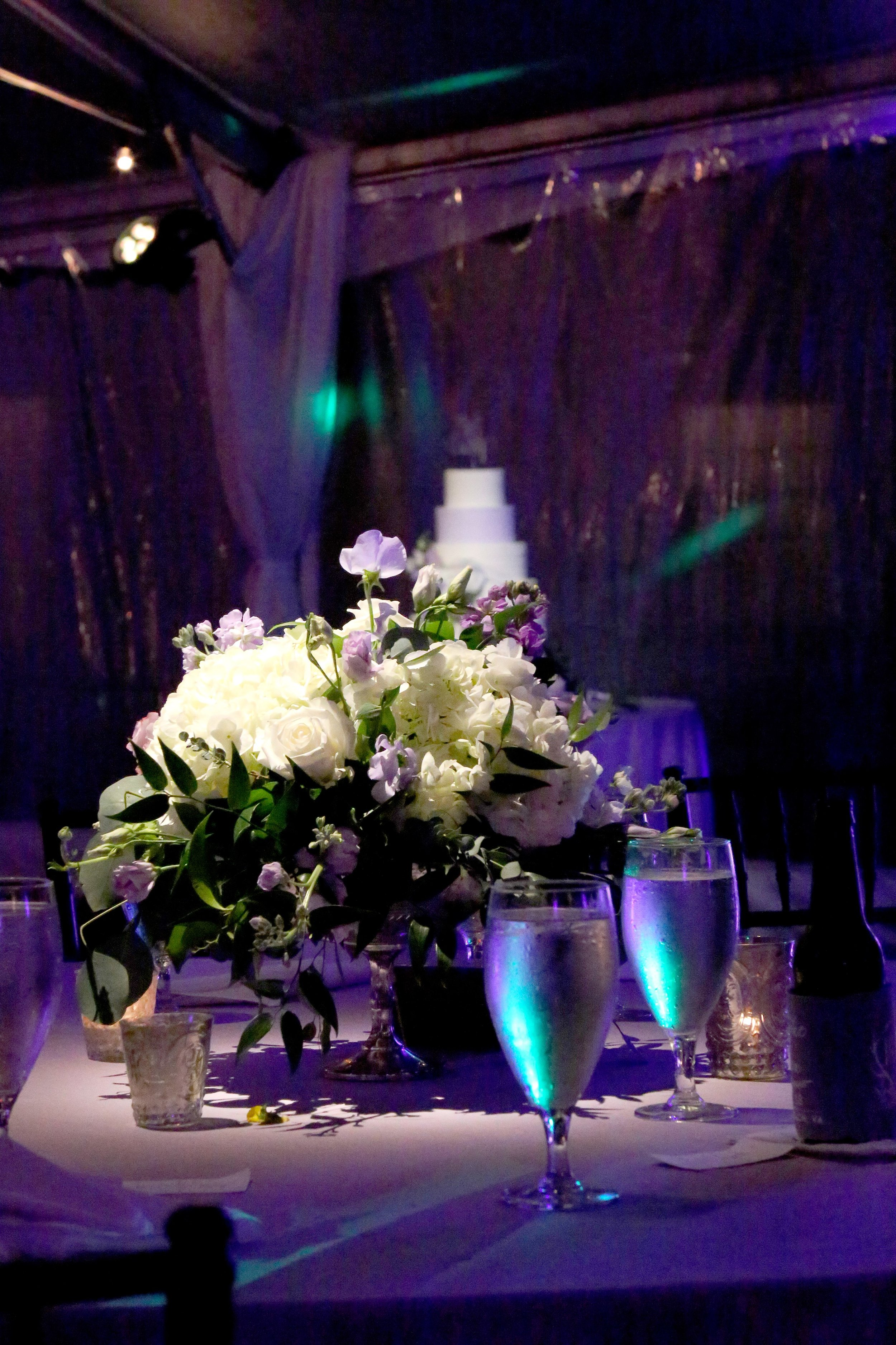 Centerpiece With Cake In The Background.jpg