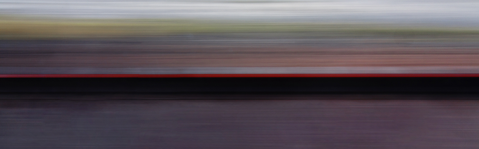The Voyage Series  This series represents an abstract departure into visualization of travel as it feels from the more personal view of one traveling, not only between the spheres of urbanity to more remote spaces, but also in a way that captures contemporary urban travel from one center to another. Being photographed on the surface of this earth, typically by train, the colors of the earth swirling past reflect the evolution and increase of the speed of travel, which has inexorably led to the urbanization of our world.