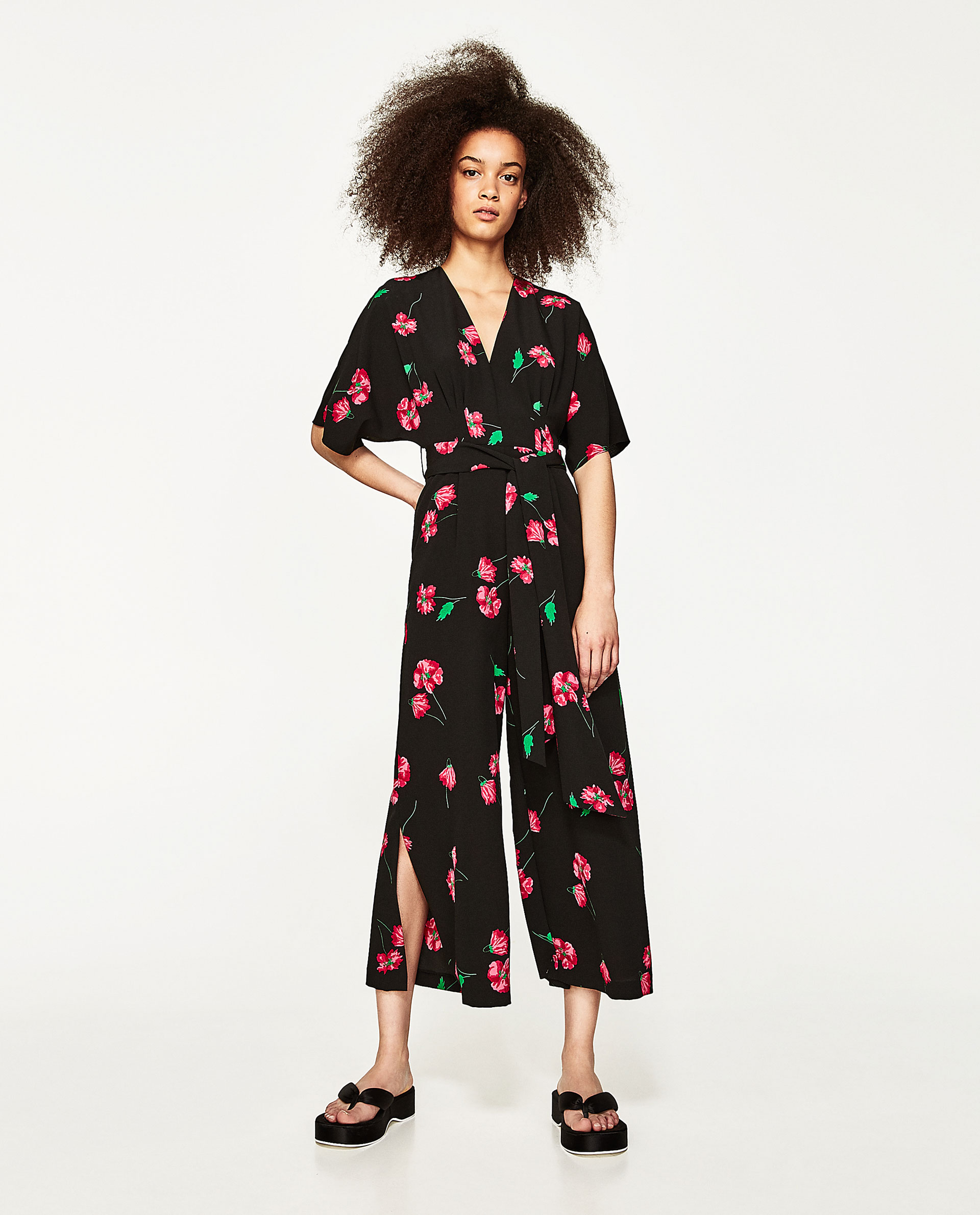Another  Zara  jumpsuit £49.99. Ignore the casual styling here and pick a fierce shoe to dress it up. Continue on a 70s vibe with these  Dune  platforms or keep it lower to the ground with these mid heel  sandals .