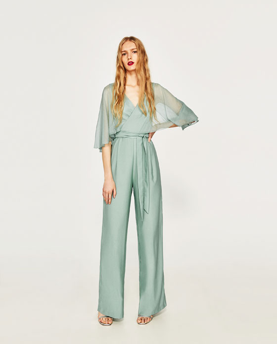 This  Zara  sea green jumpsuit is an absolute beauty and at £59.99 an absolutely beautiful price too. The sheer cape is incredibly flattering and perfect if you are feeling arm conscious. Style with a simple strappy sandal as they have done here. Or a raffia wedge and play up the 70s Bianca Jagger vibe.