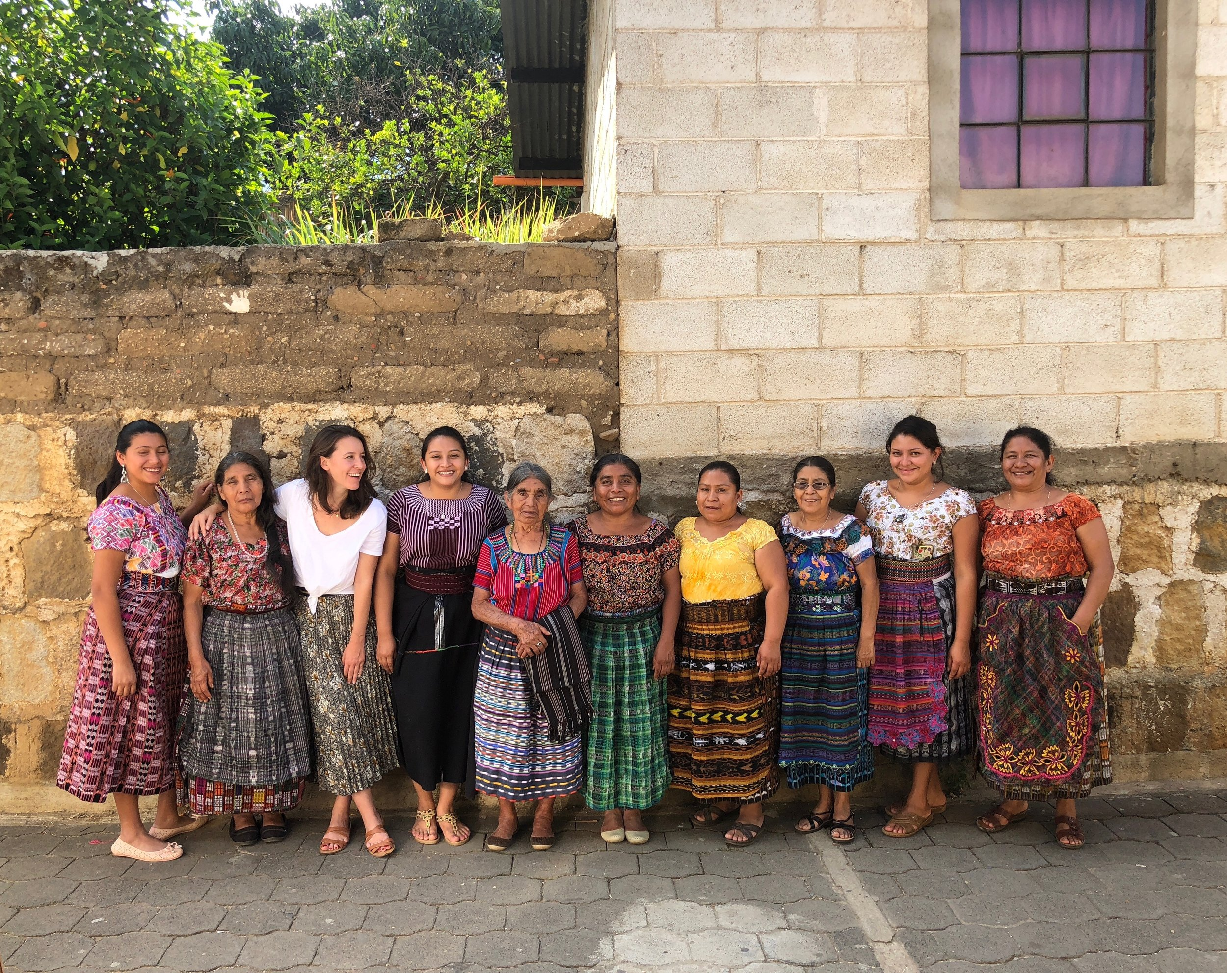 Behind the Hill's founder Maud Lerayer with the Master weavers in Guatemala