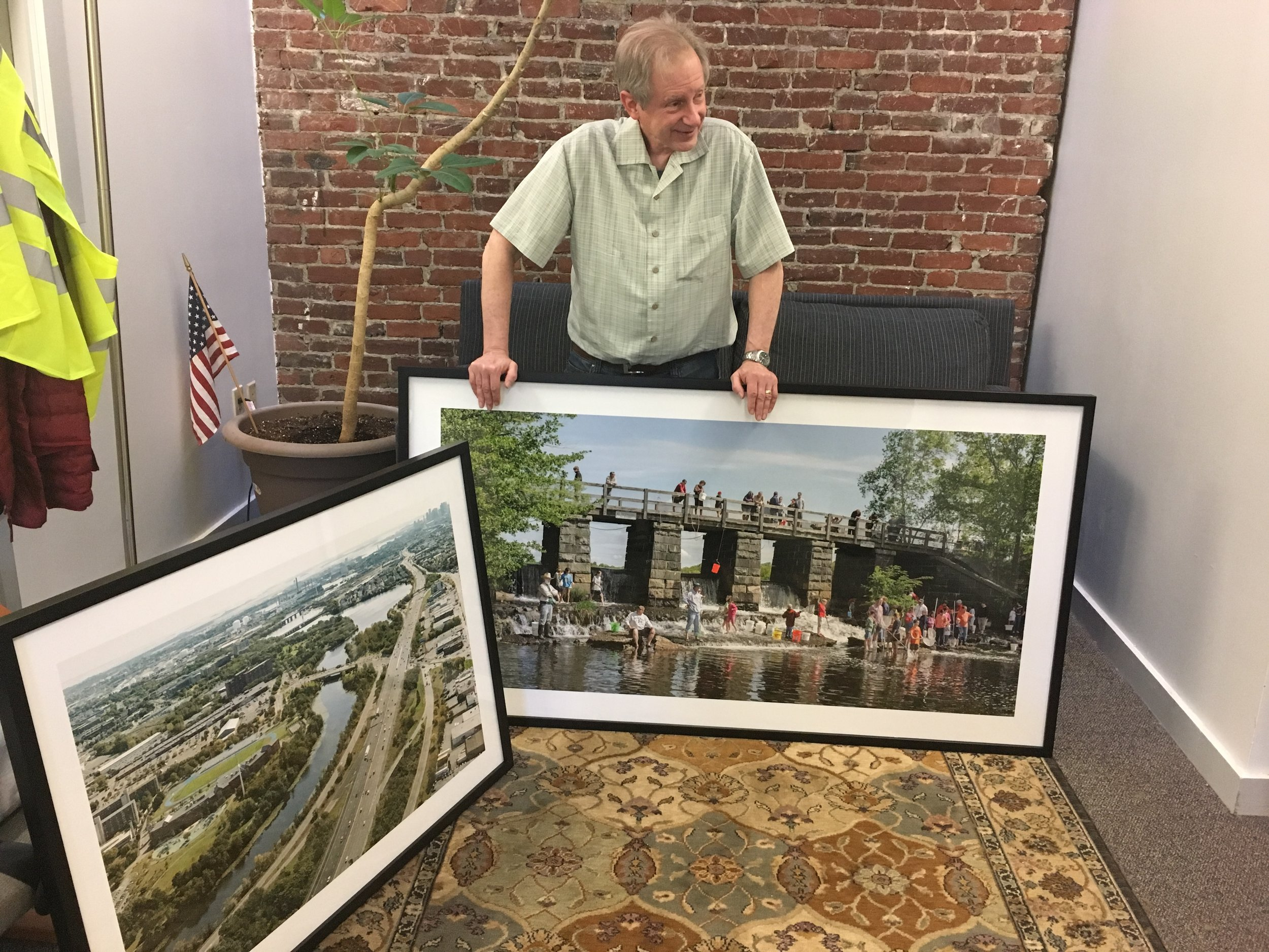 David Mussina, local volunteer and photographer, donated photos to liven up the MyRWA office. Stop by to see this one capturing the bucket brigade!