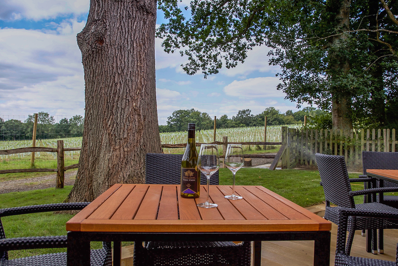 Enjoy a glass of wine on the deck overlooking the vineyard