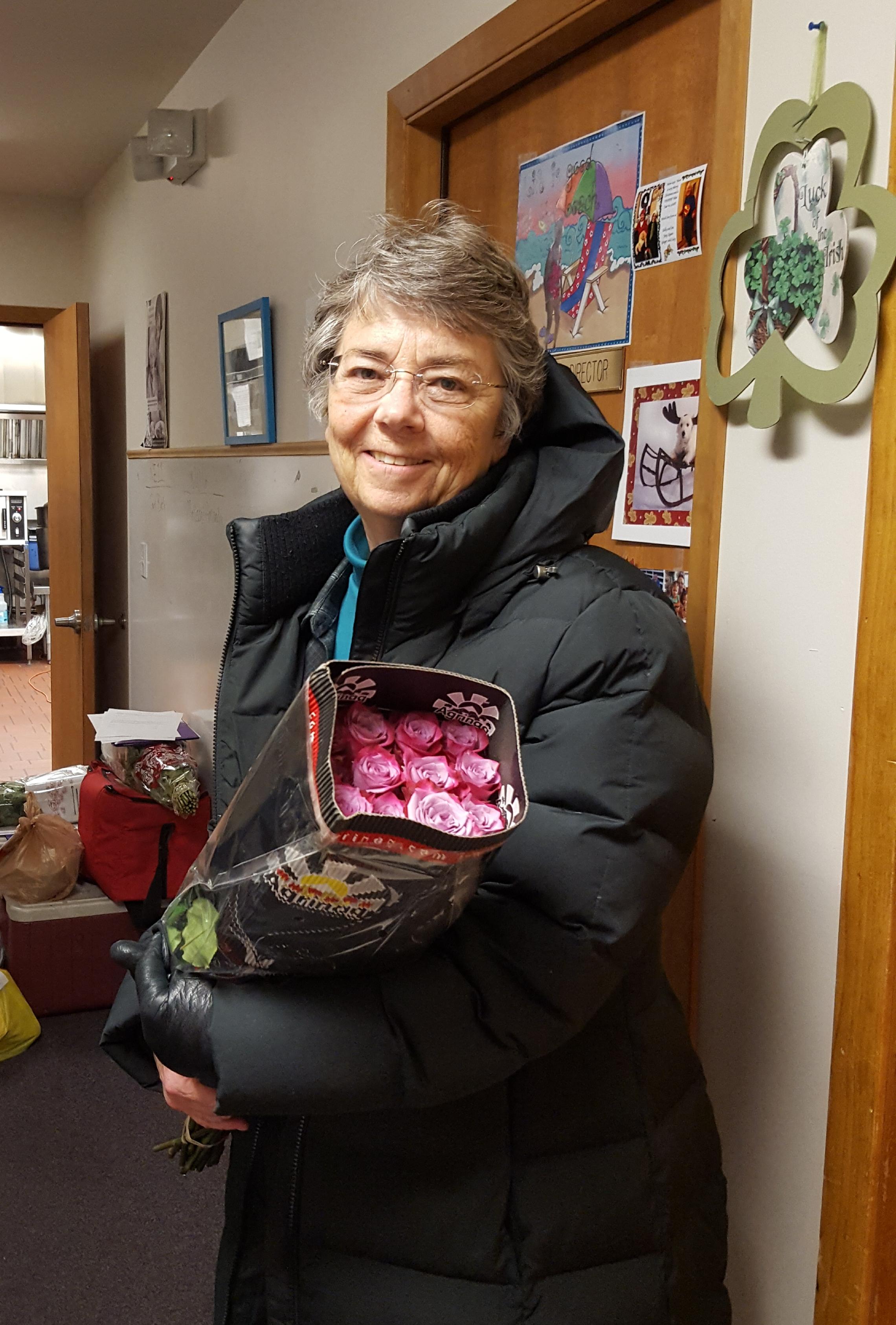Volunteer Cathy delivering flowers to seniors on her route, 2-22-18.jpg