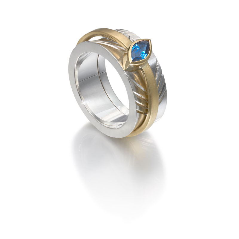 Engraved silver outer ring, 18ct gold inner ring with sapphire