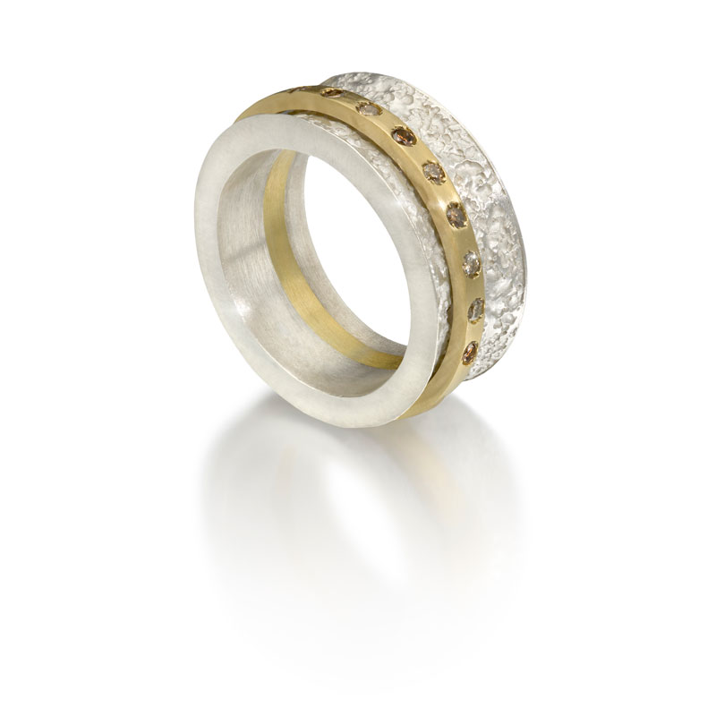 Etched silver outer ring, 18ct gold inner ring with cognac diamonds
