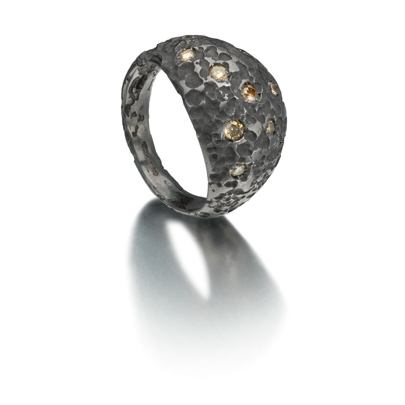 Black rhodium plated etched silver bombe ring with diamonds